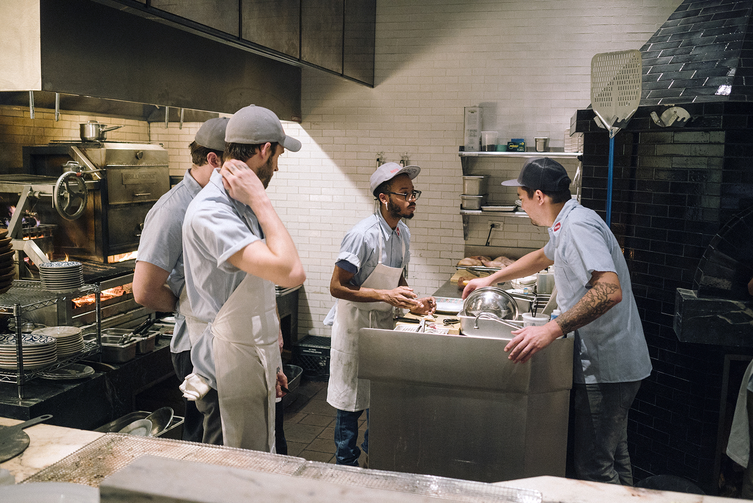 Chef Nick Anderer (far right) instructing his team.