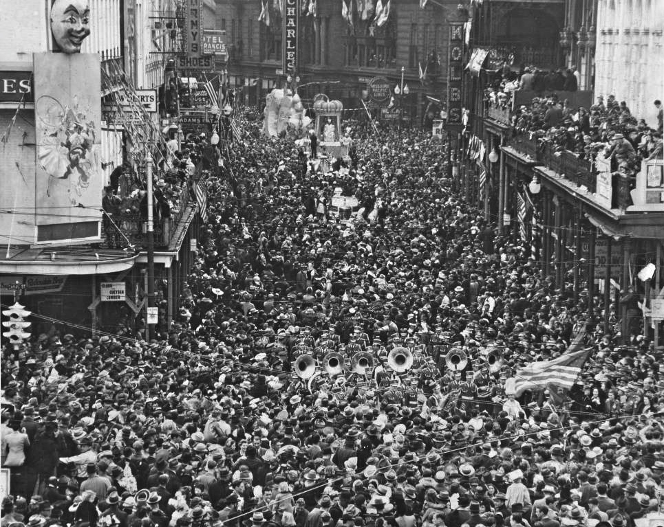 New Orleans Mardi Gras parade passing down  the 100 Block of St. Charles Avenue to Canal Street, 1930s