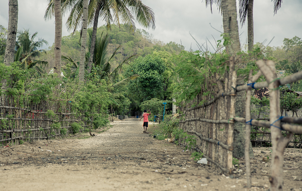 A young boy strolls along a road in Watu Karung, Java, a village comprising of possibly the friendliest collective of genuine humans I have ever encountered anywhere.