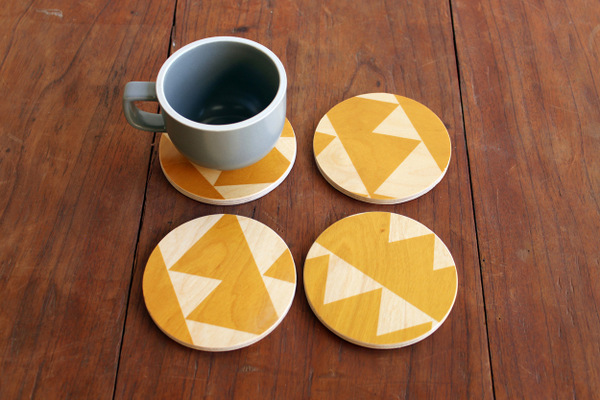 Wolfum Yellow Triangles Coasters set of four $34
