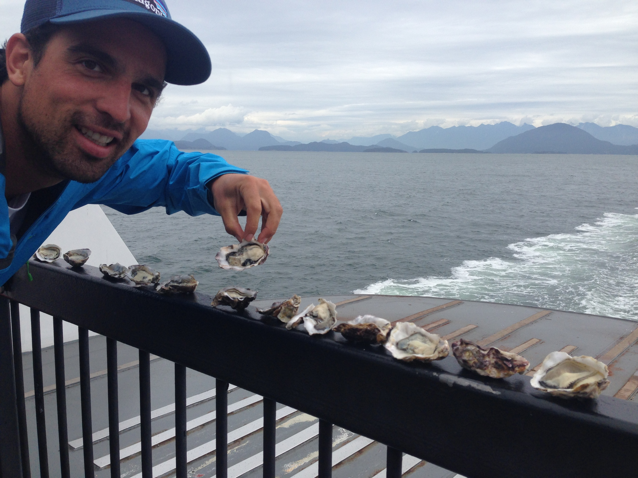 Where to eat NZ Kaipara Oysters? Everywhere...here is VP of 46 South, Jeremy Hill enjoying the Kaipara Oysters while taking the ferry from Vancouver to Nainamo