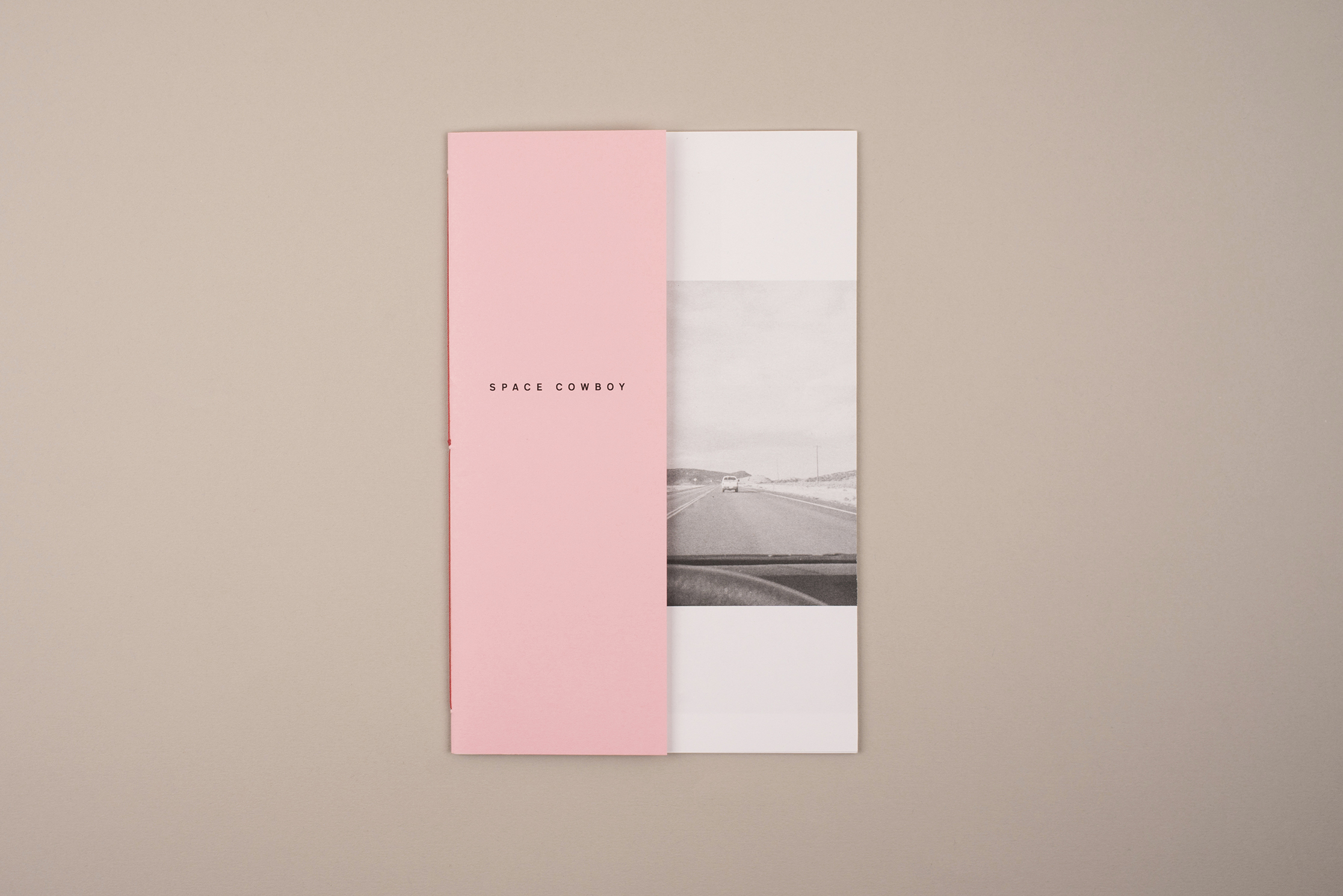 Space Cowboy zine, photography by Jack Latham. Poem by Sofia Kathryn Smith. A zine about hitchhiking in America. Light Pink half sized cover.