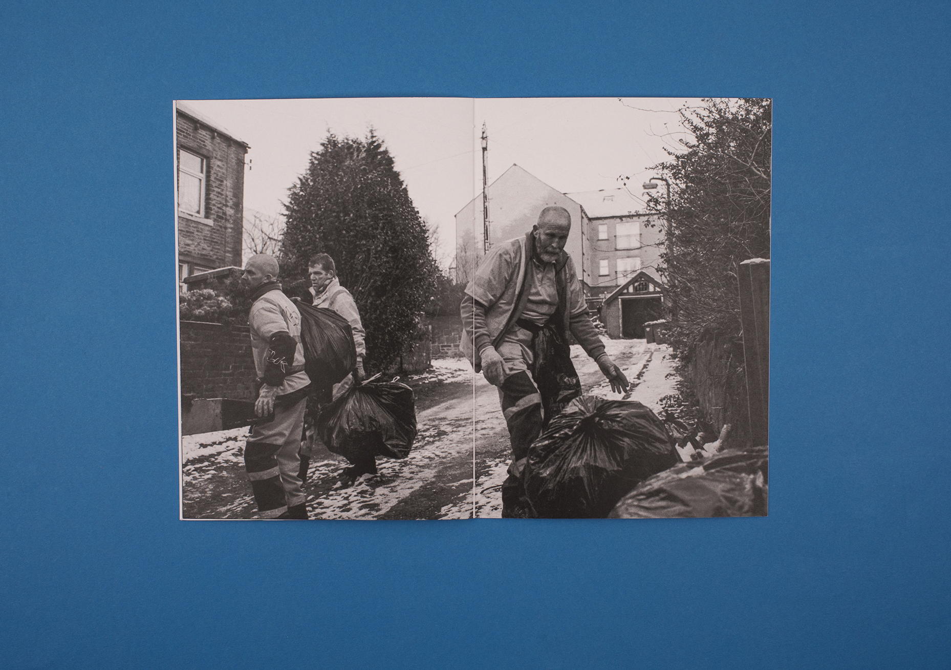 Beyond Work Zines by Photographer Curtis James. Black and white double page photograph from 'refuse collector' zine.