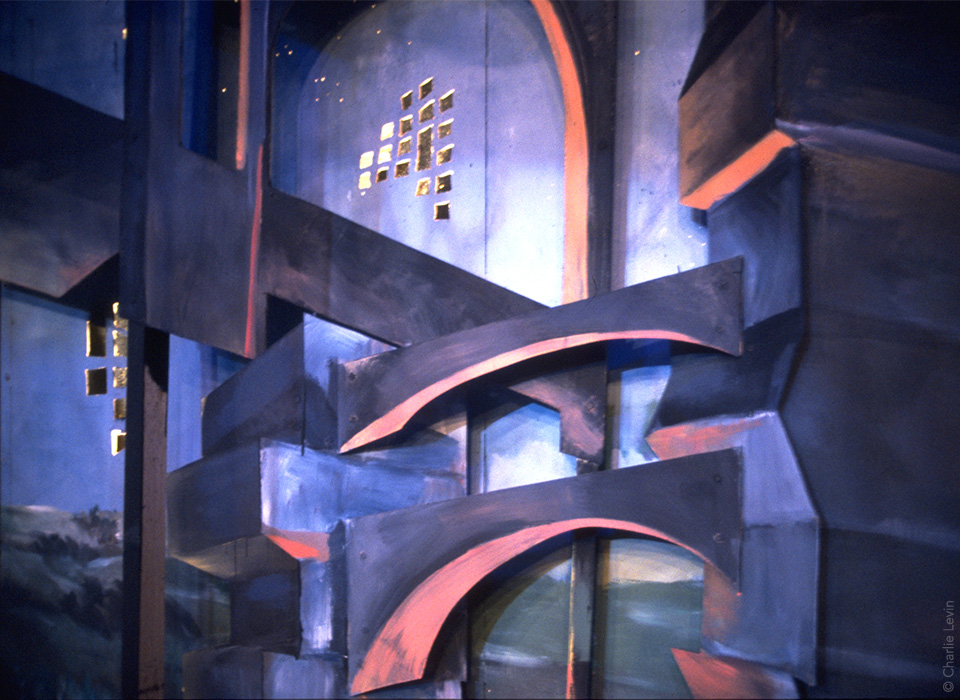 Back wall of Ironmistress set at Heartland Studio Theater, Chicago. Over the course of the show, lights rose through cutouts of skyscraper windows, indicating layers of technology over time — landscape, industry, urbanity.