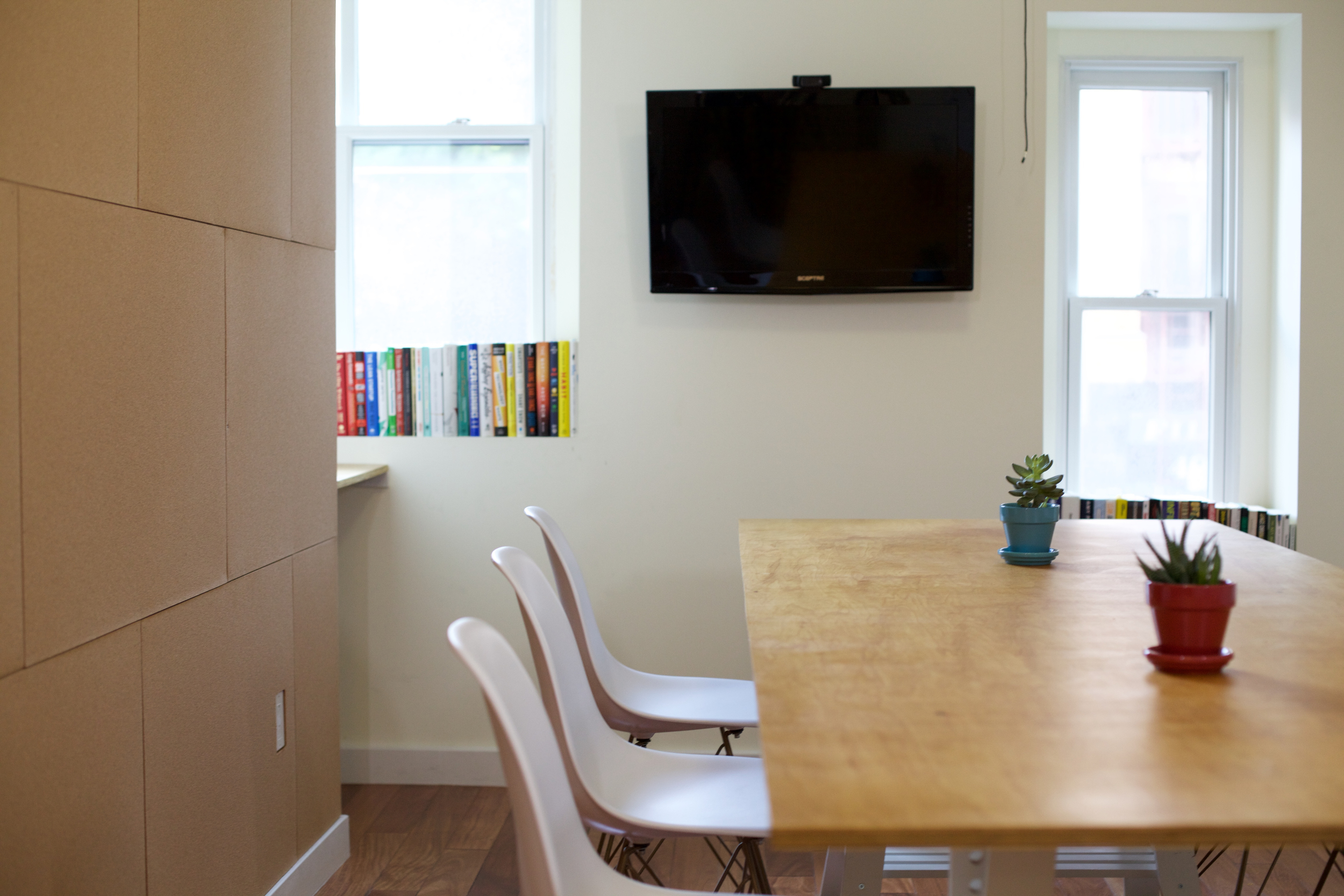 zmaic-one-month-interior-design-conference-room-corkboard-wall-custom-table.jpg