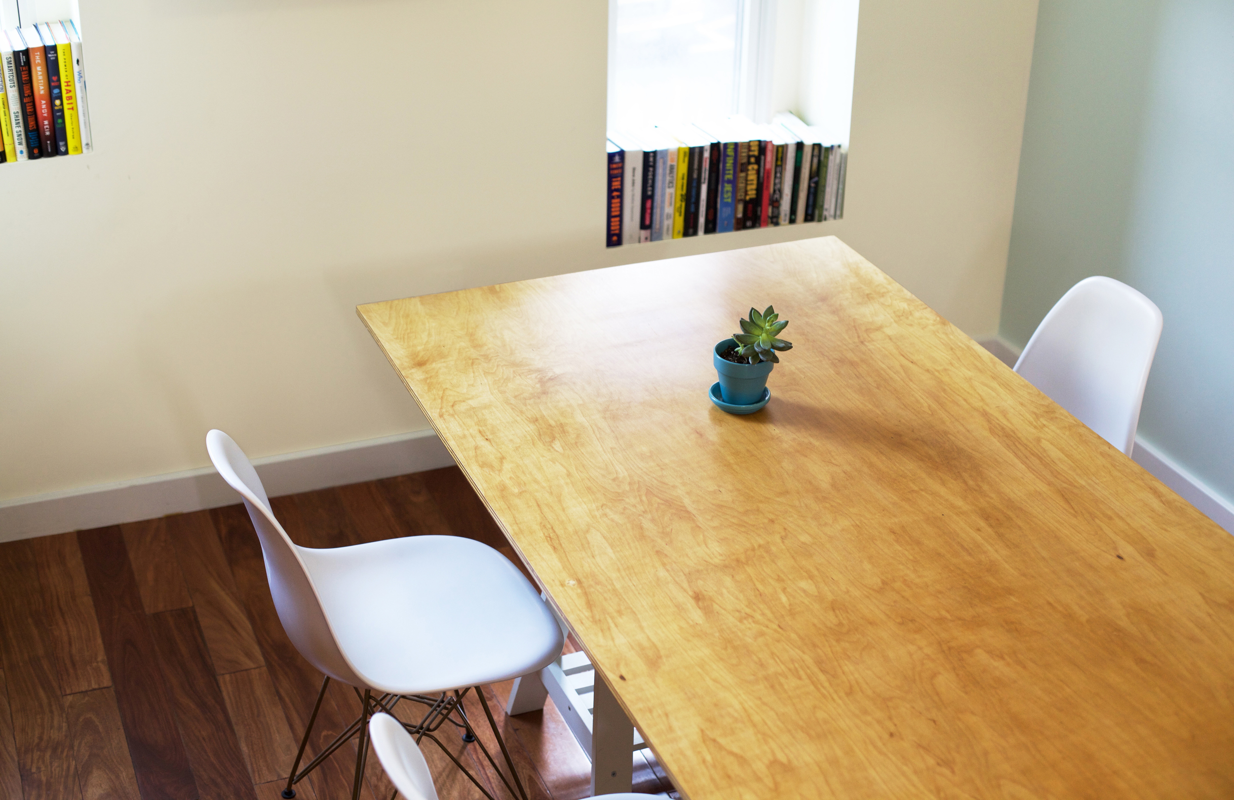 zmaic-one-month-interior-design-conference-room-workspace-custom-table-plant-books.jpg