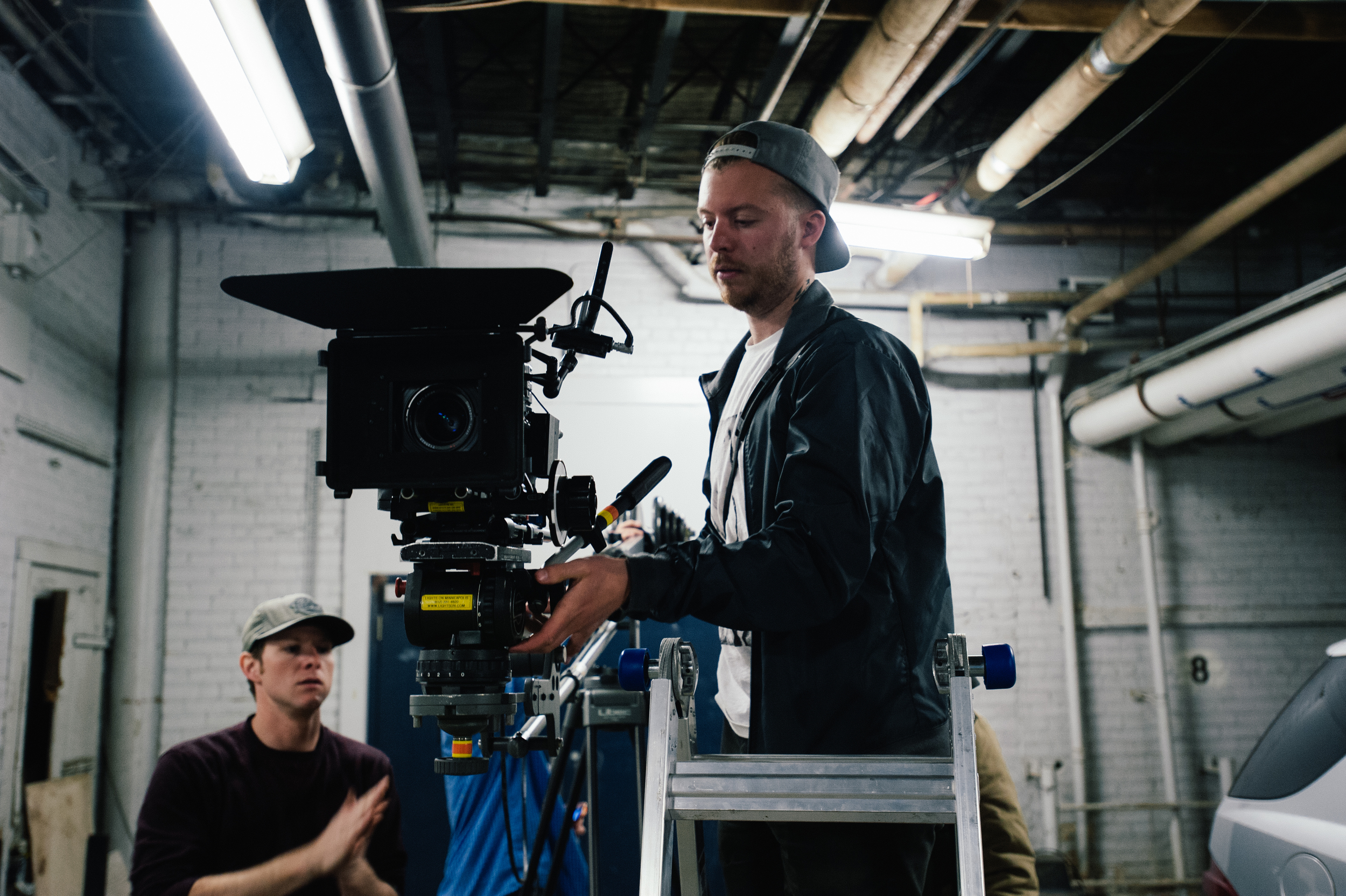 CInematographer Kevin Horn uses a ladder to get his camera into position