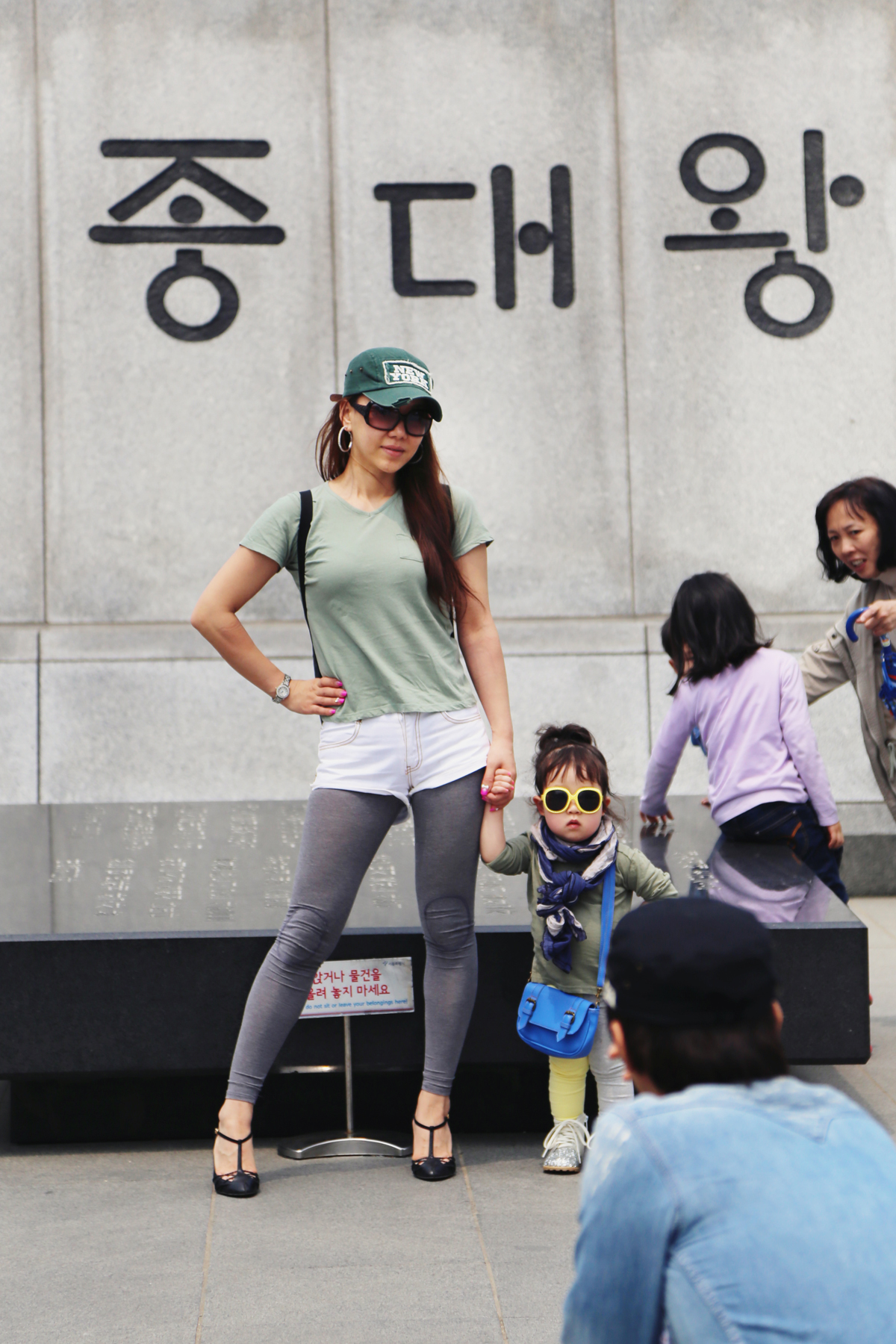 Saw this cute little girl posing for her dad: