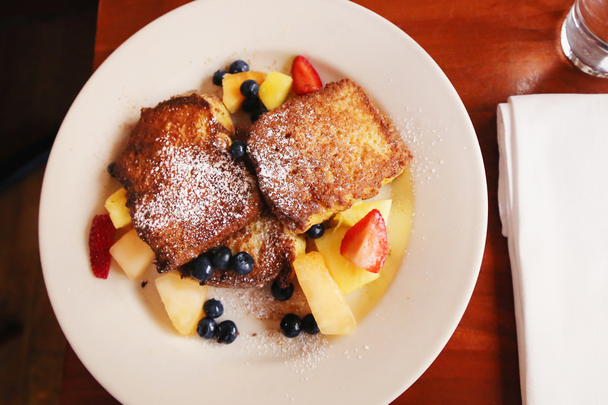 French French Toast (Fried in Bourbon Egg Batter, served with Maple Syrup and topped with fresh fruit.)