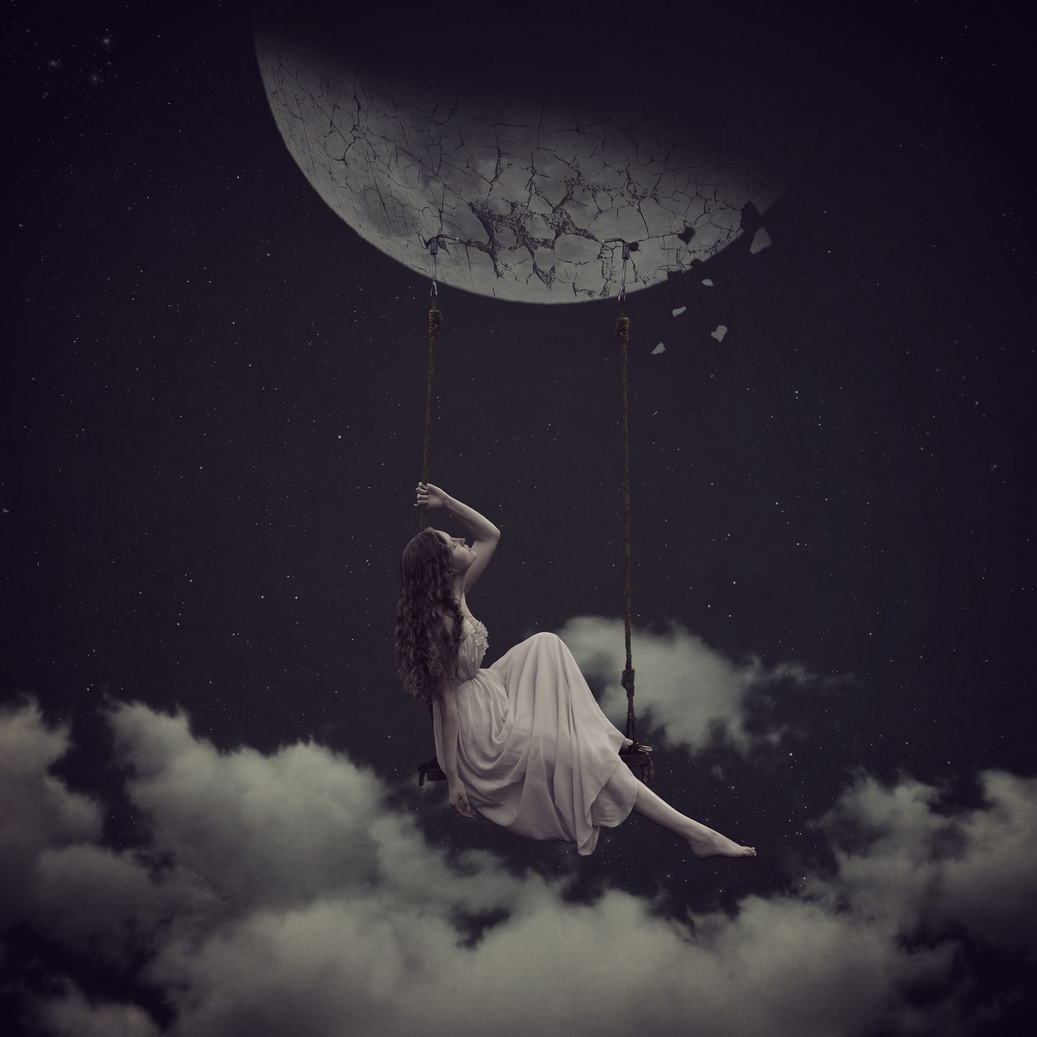 She wanted it so much... to hang by the moon and swing in the clouds. But her plans became disenchented when the moon began to fall apart, much like her dreams.