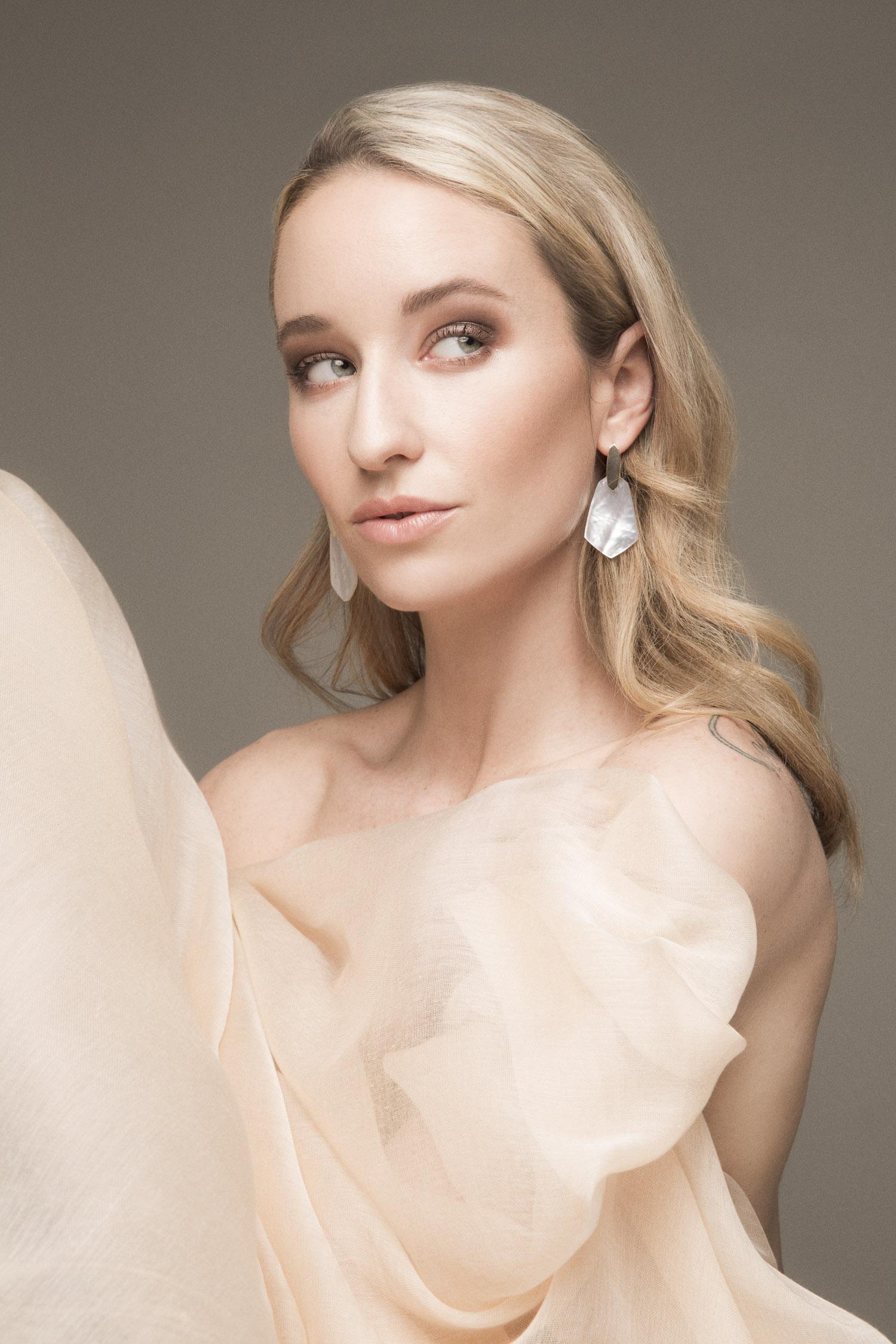 Beauty portrait of a woman wearing Kendra Scott earrings