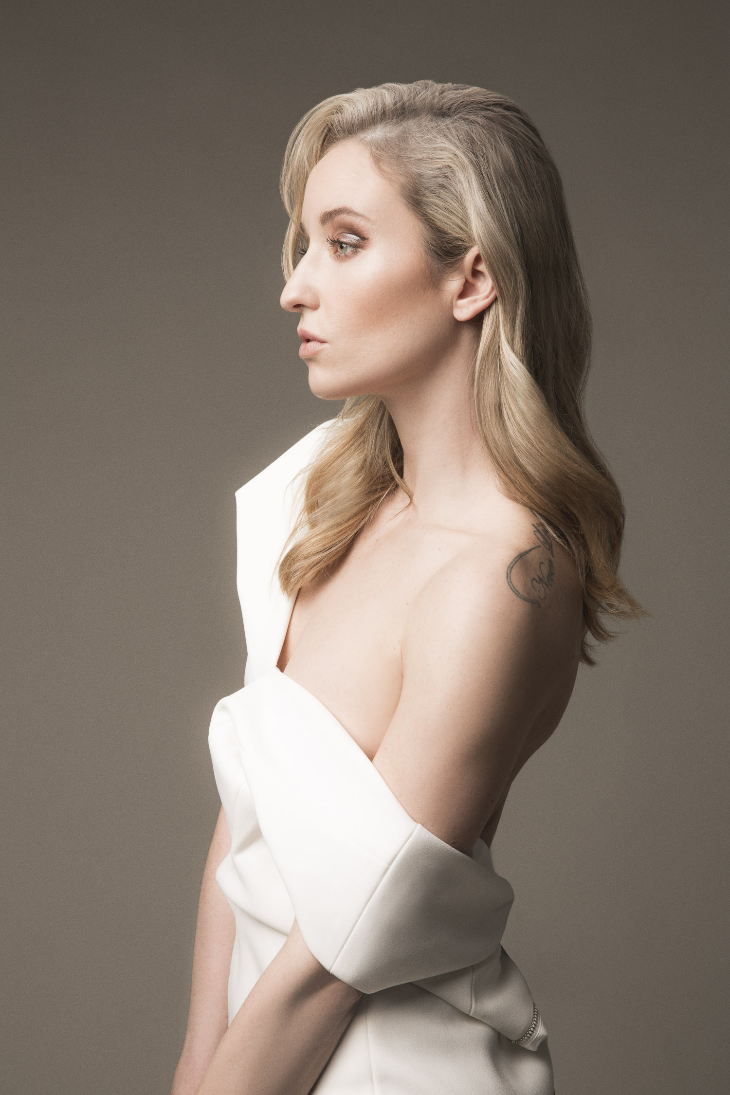 Model profile in a white Ted Baker pencil dress