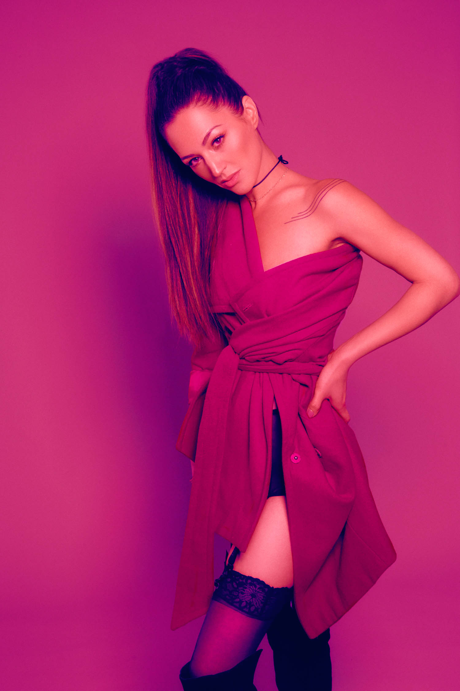 Model in hot pink trench coat for boudoir session