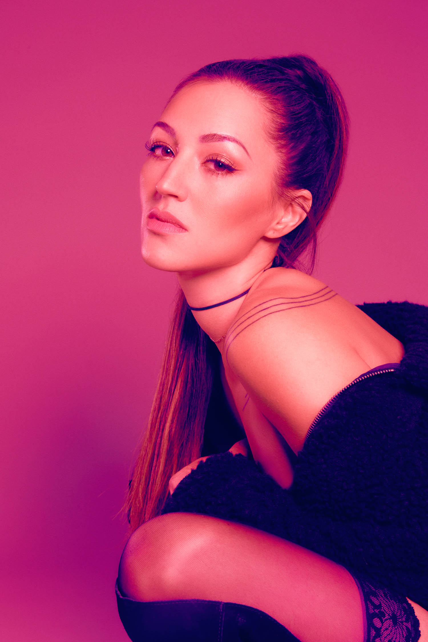 Model with choker and Ariana Grande style ponytail