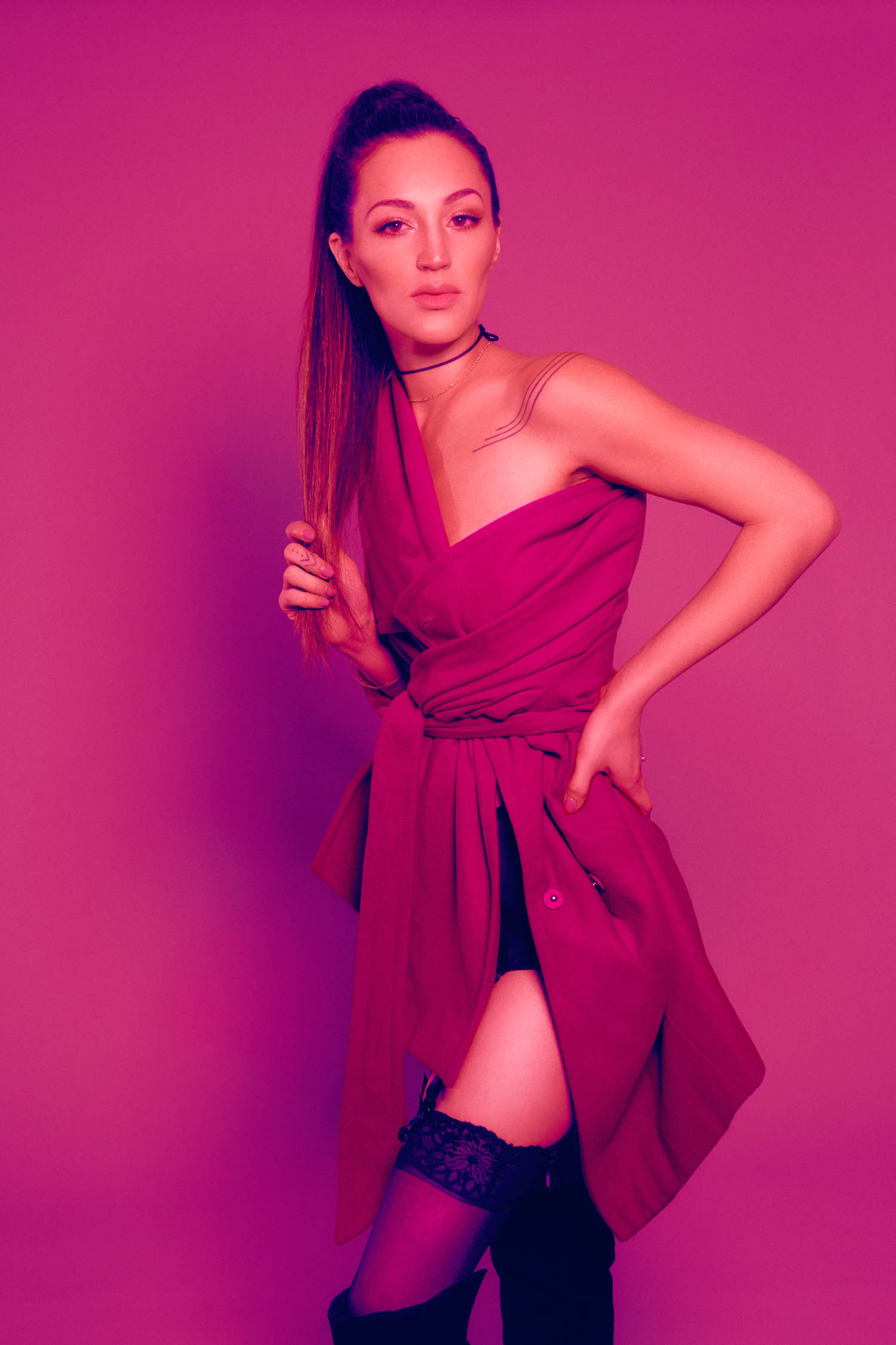 Boudoir session on pink background with pink trench coat