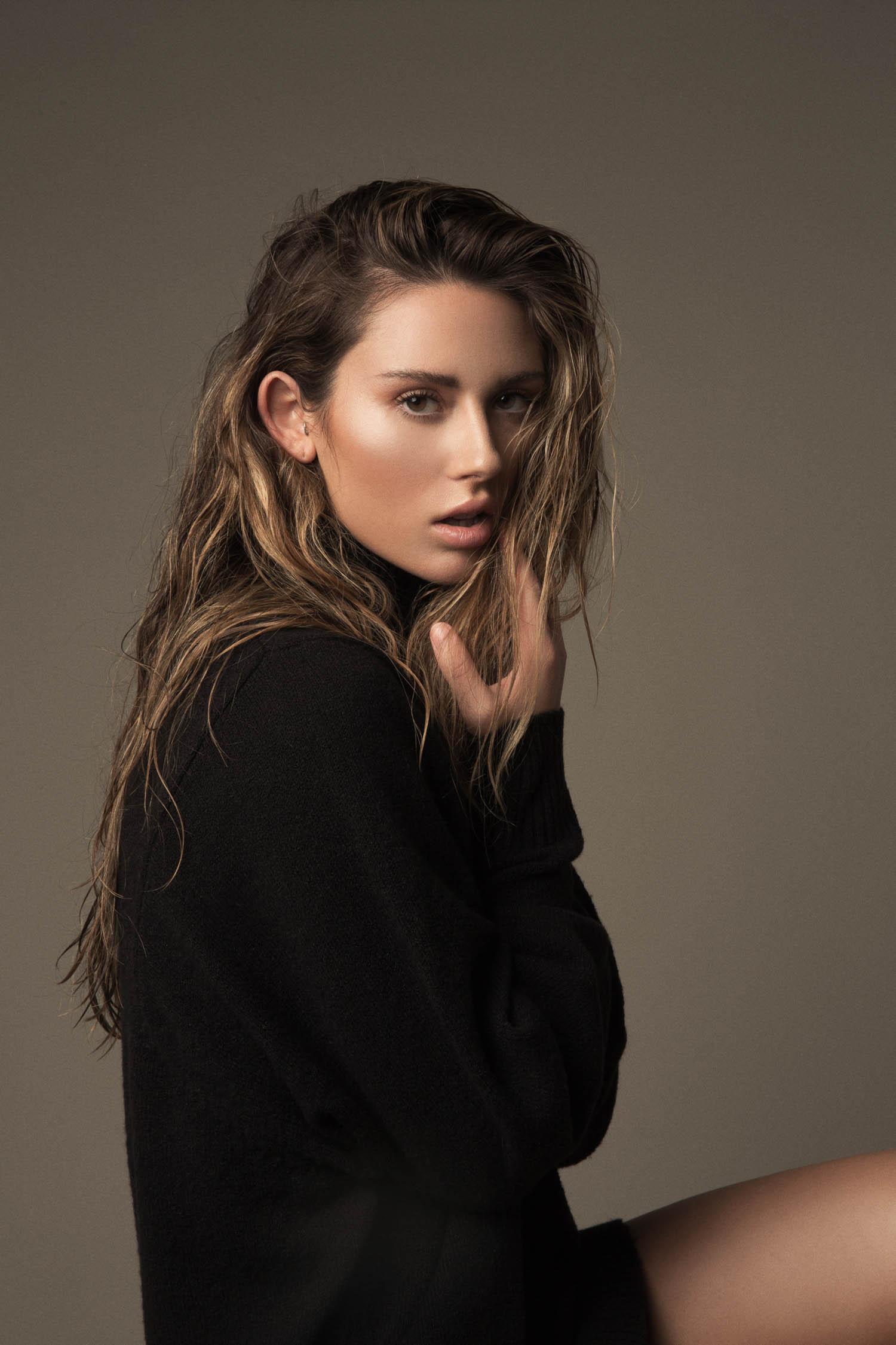 Model test wearing black turtle neck.