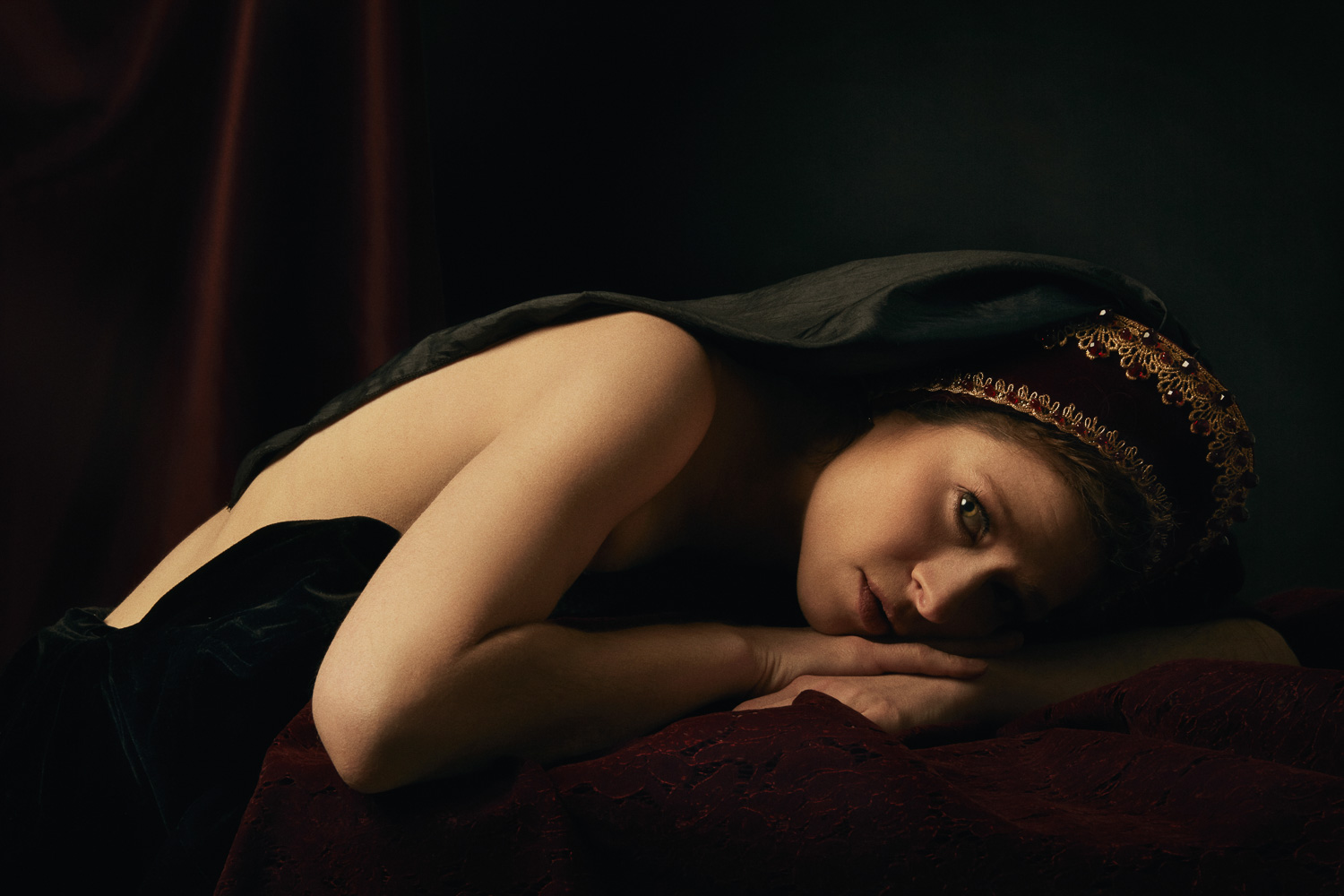 Renaissance style boudoir photography with a French hood.