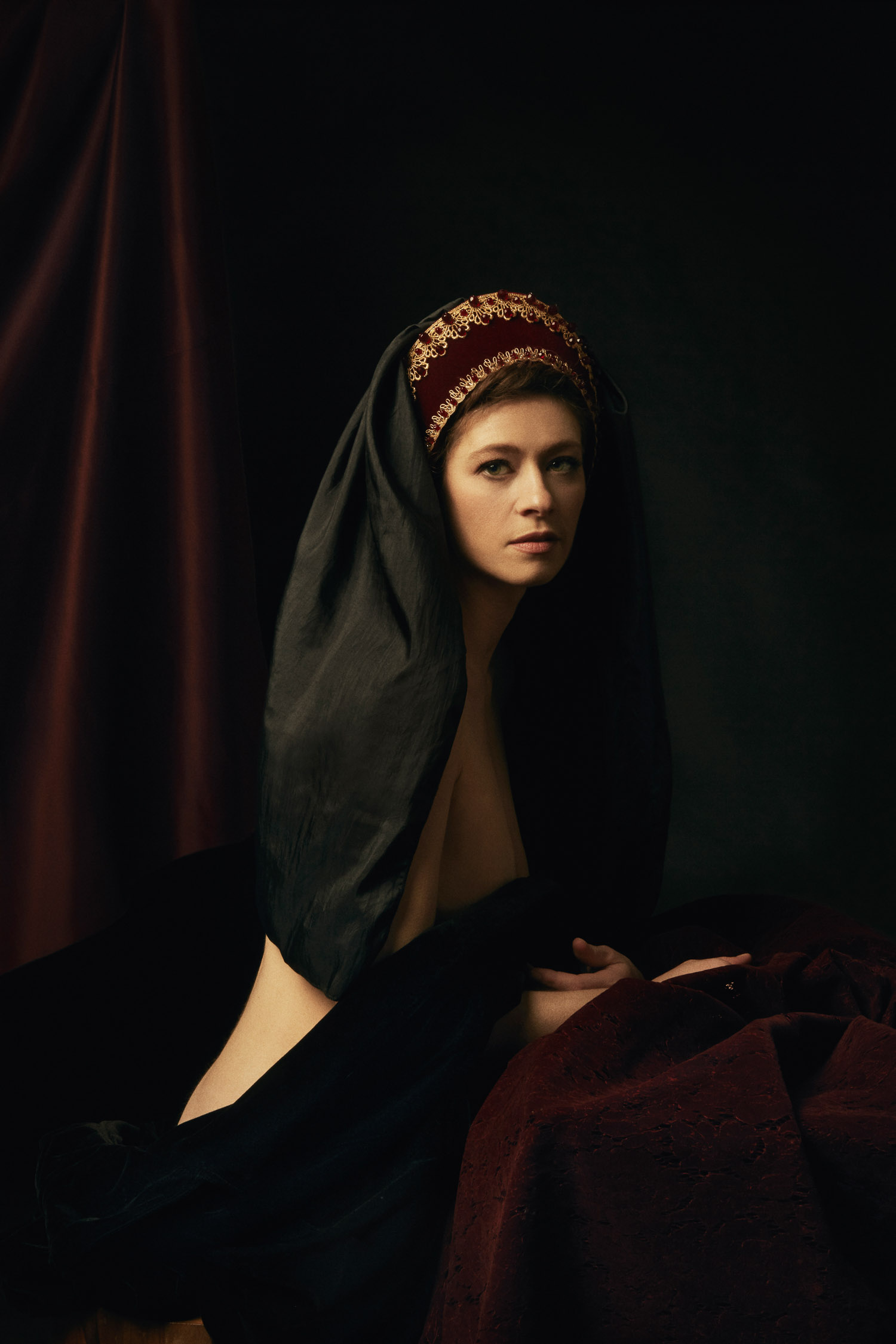 Renaissance themed photography of a woman in a French hood