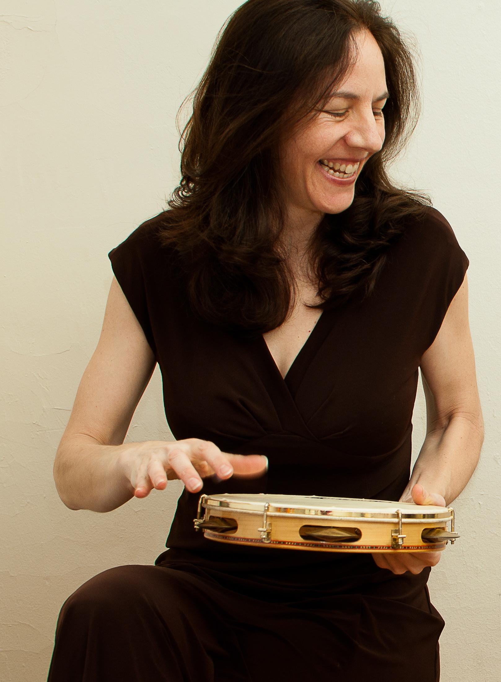Jennifer playing the pandeiro, 2012.