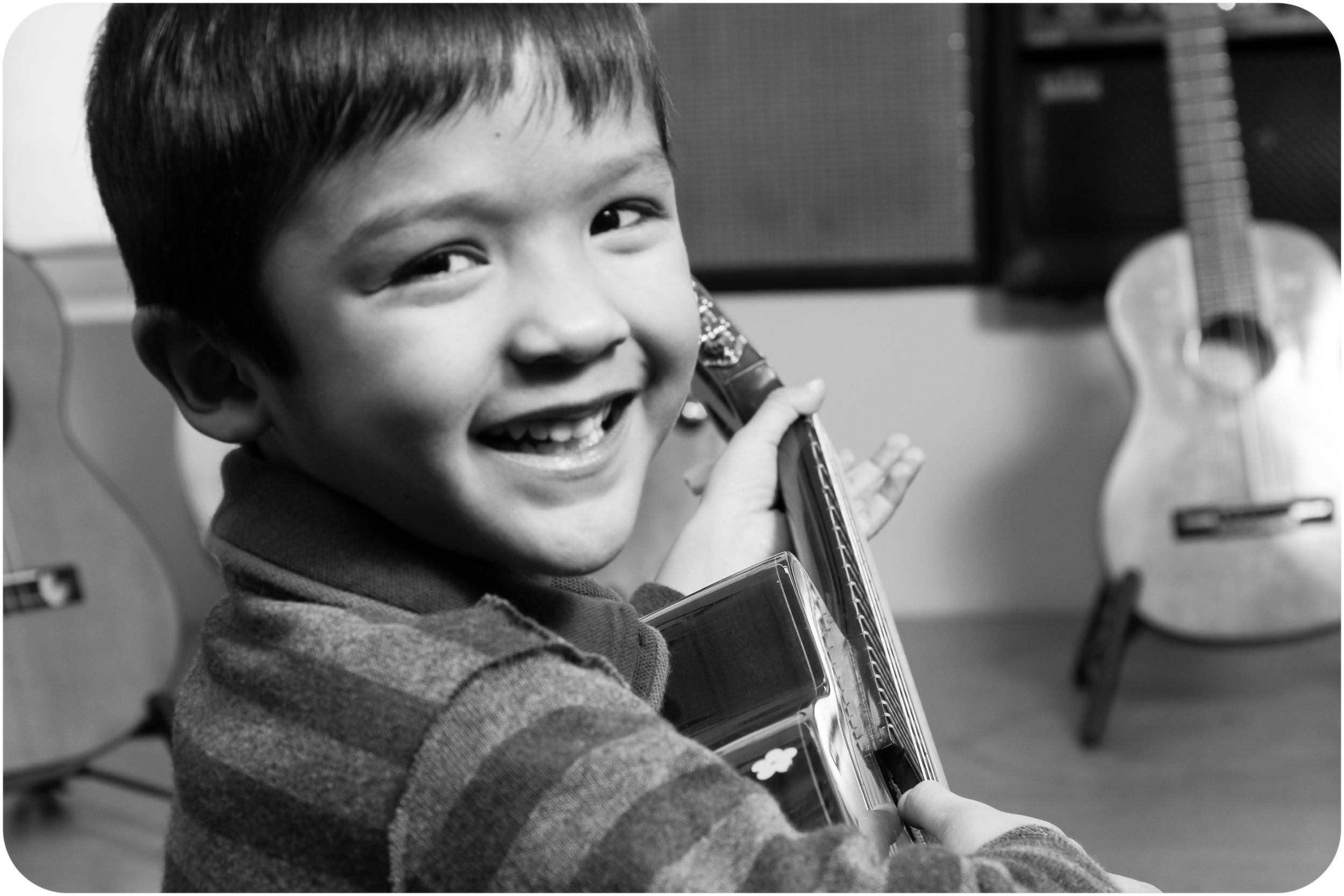 Noah's first guitar lesson.