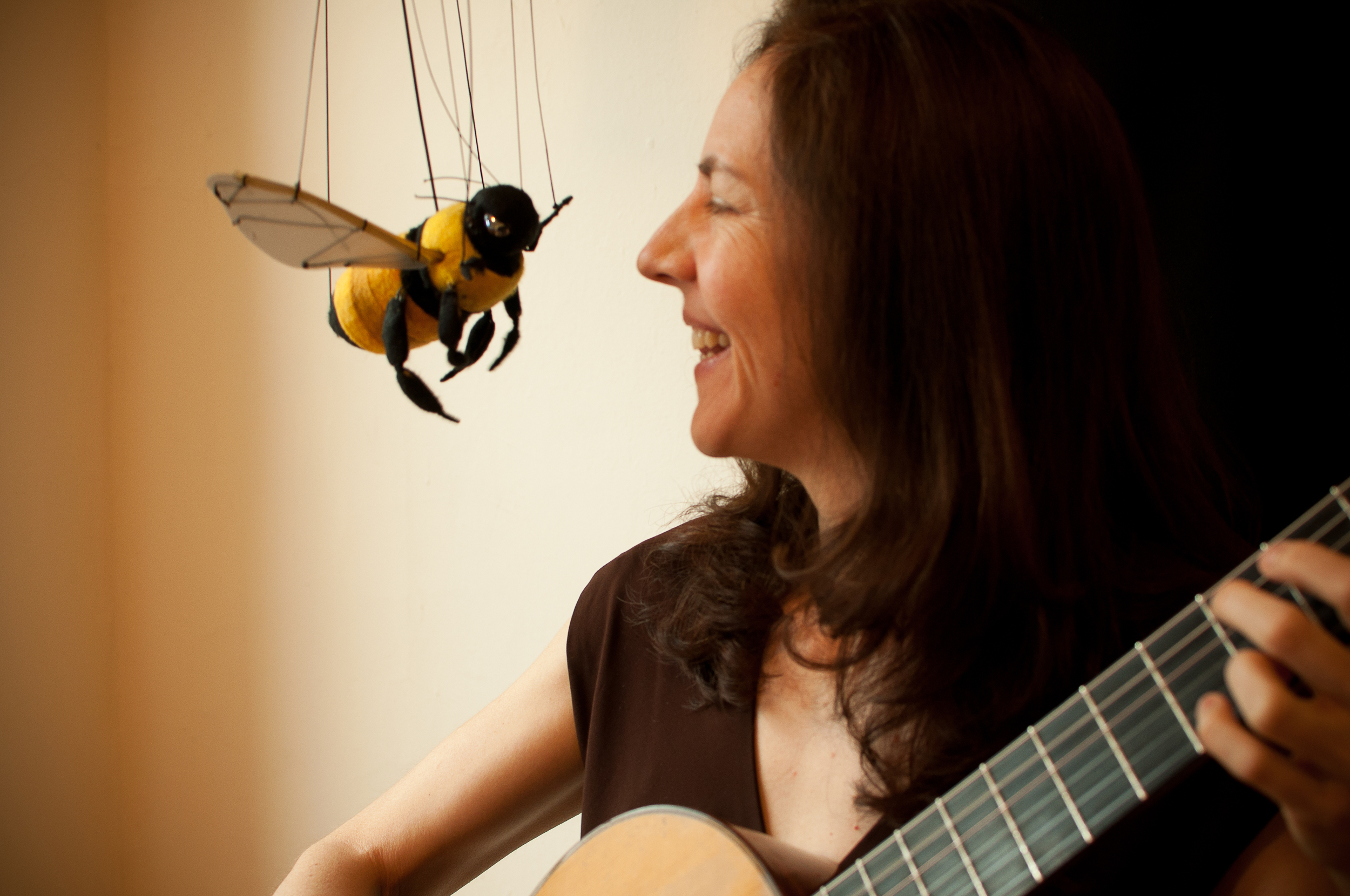 "Jennifer performing ""El Abejorro"" by Emilio Pujol with Jabberwocky Marionettes, 2012."