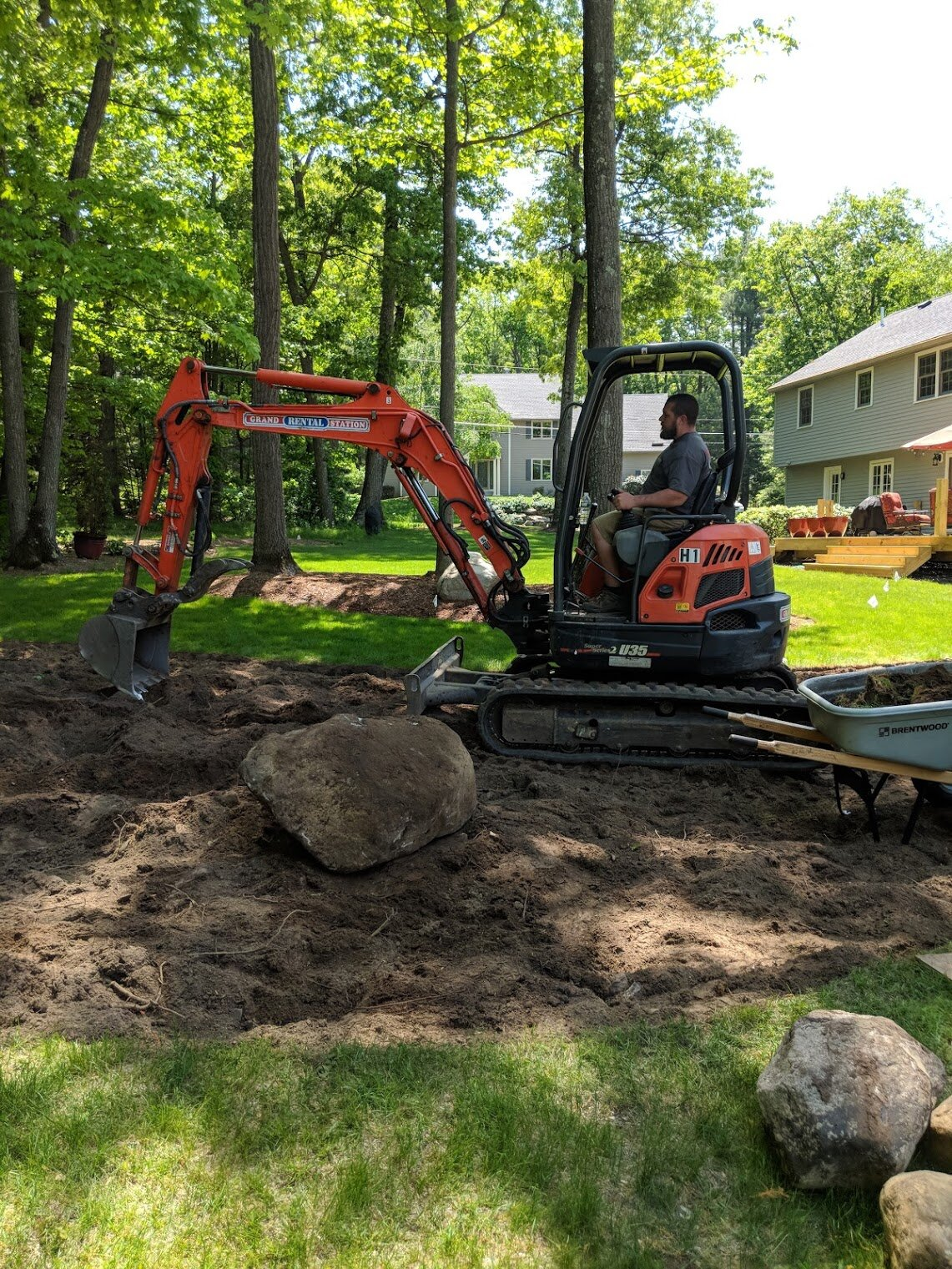 Gorgeous huge boulders are unearthed and will be repurposed throughout the finished bed.