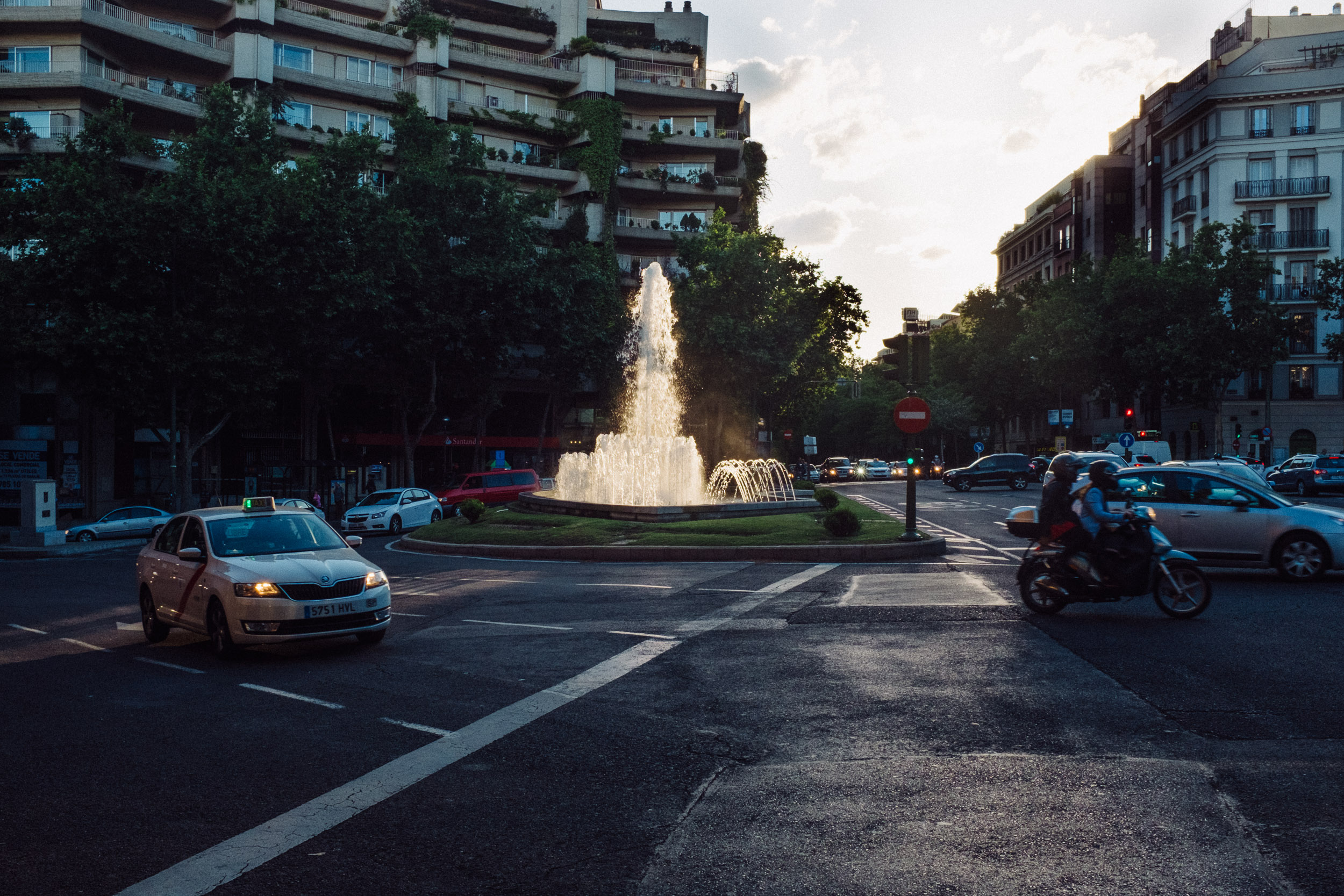 Cars passing fountain in a roundaboutin Madrid, Spain