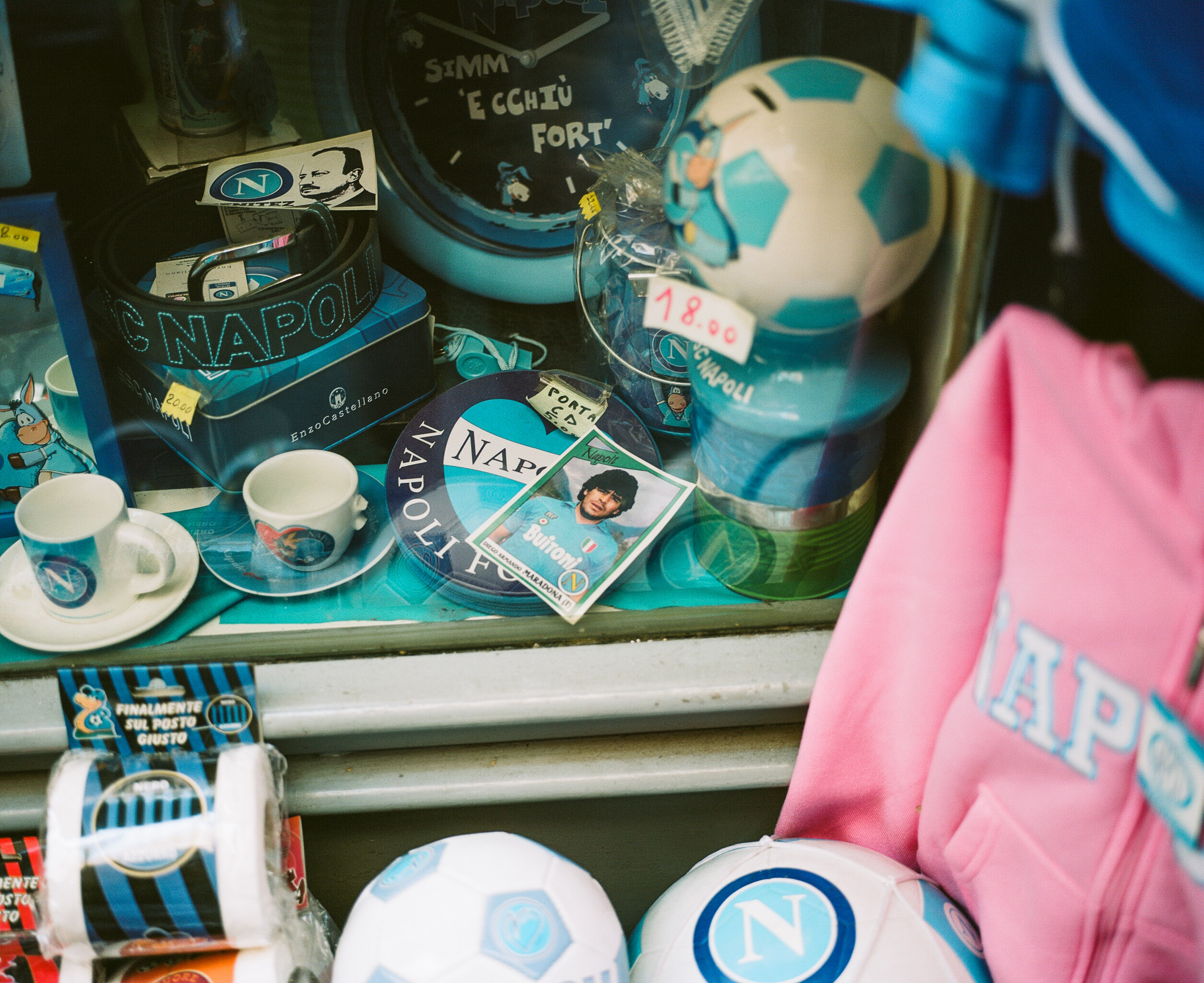 Maradona card and other sports paraphinalia in a window in Naples, Italy