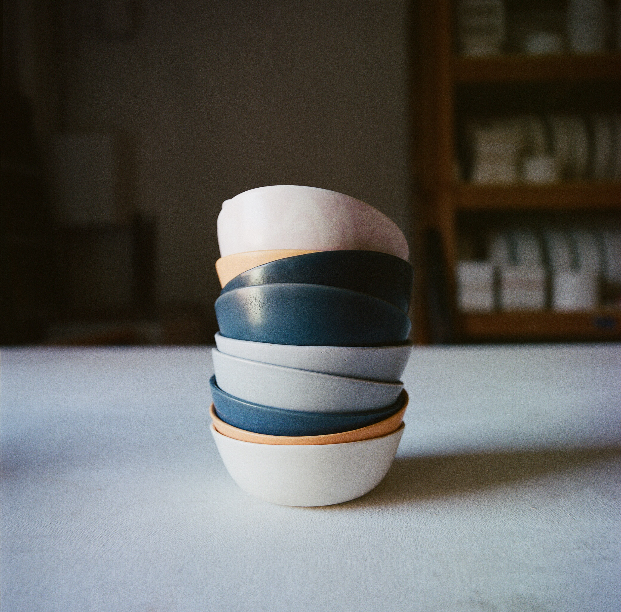 Stack of multi-colored ceramic bowls by Felt+Fat