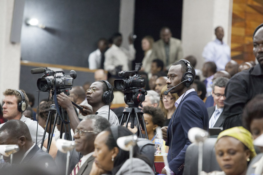 ADMA student Lievain Rucyaha operates one of three cameras during the threedays of hearings in Parliament.