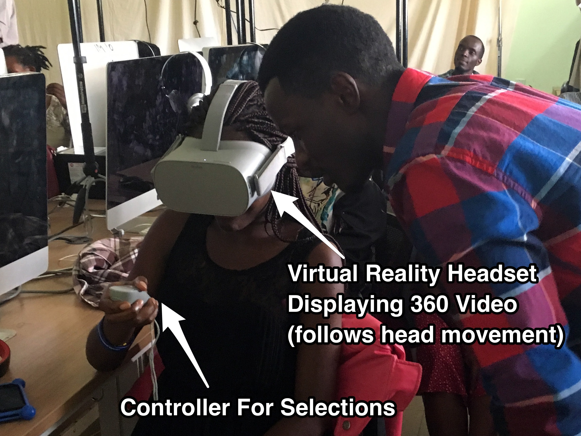 An ADMA student tries out the Oculus Go VR (Virtual Reality) headset with the help of ADMA student.