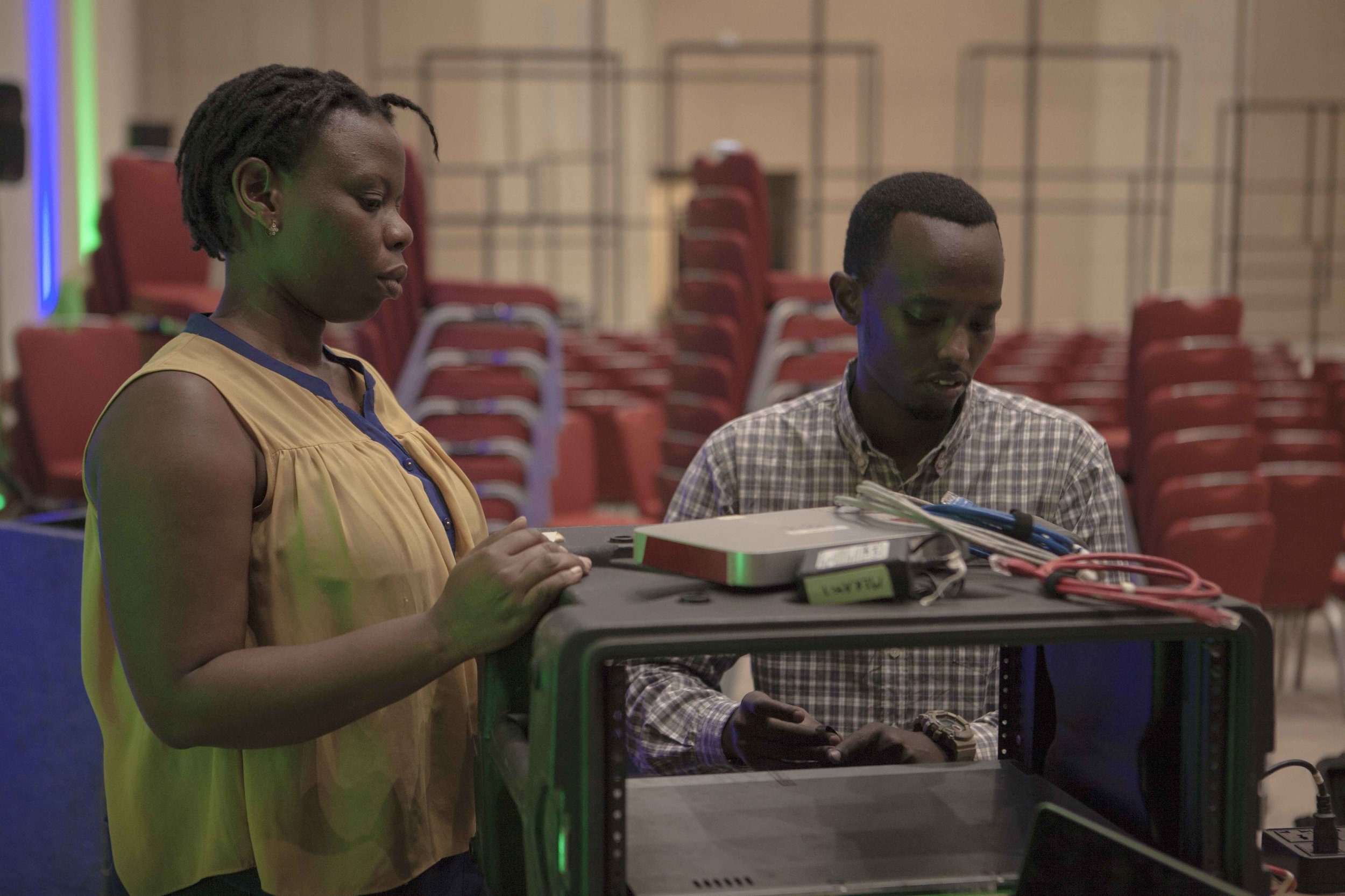Joselyne Dusabe and Alan Tuyikunde setting up the Cisco Meraki and hardware encoder Elementals that will be used for live streaming purposes