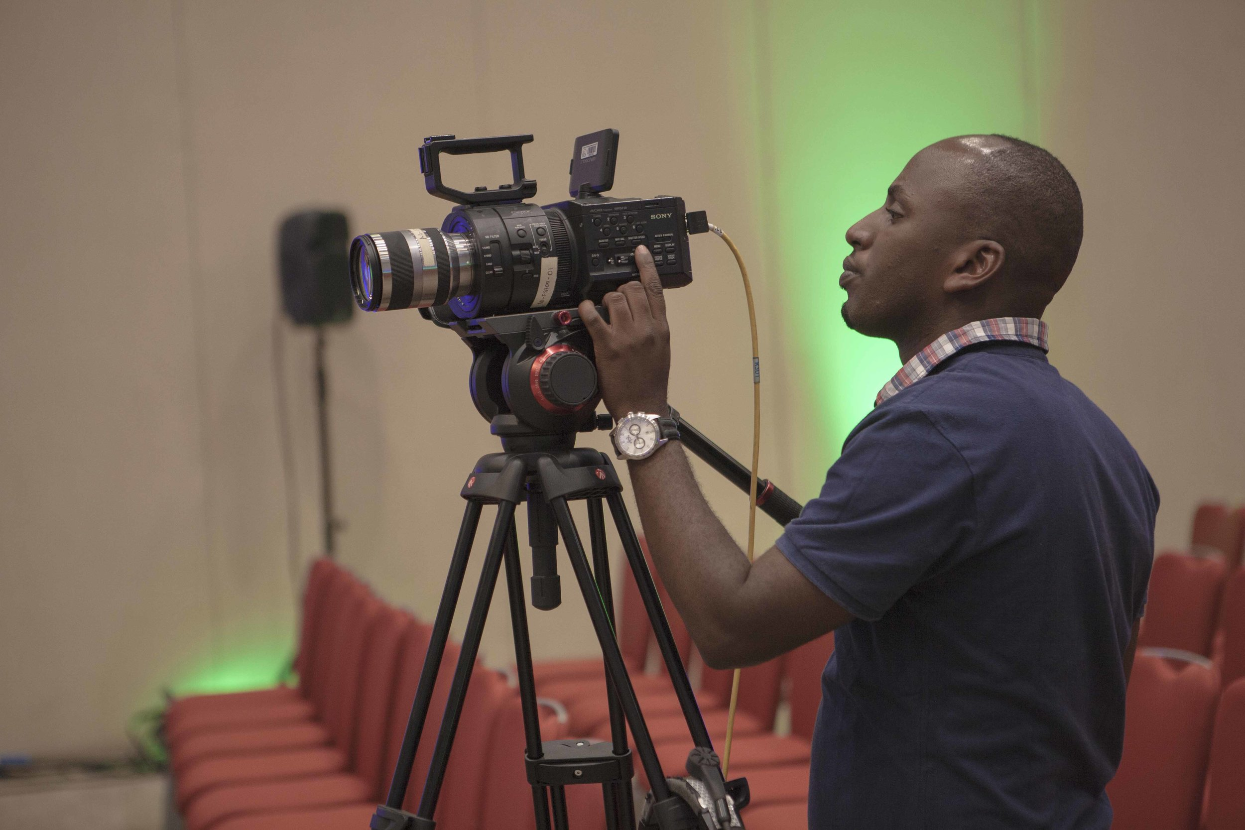 Desire, one of ADMA students setting up the camera