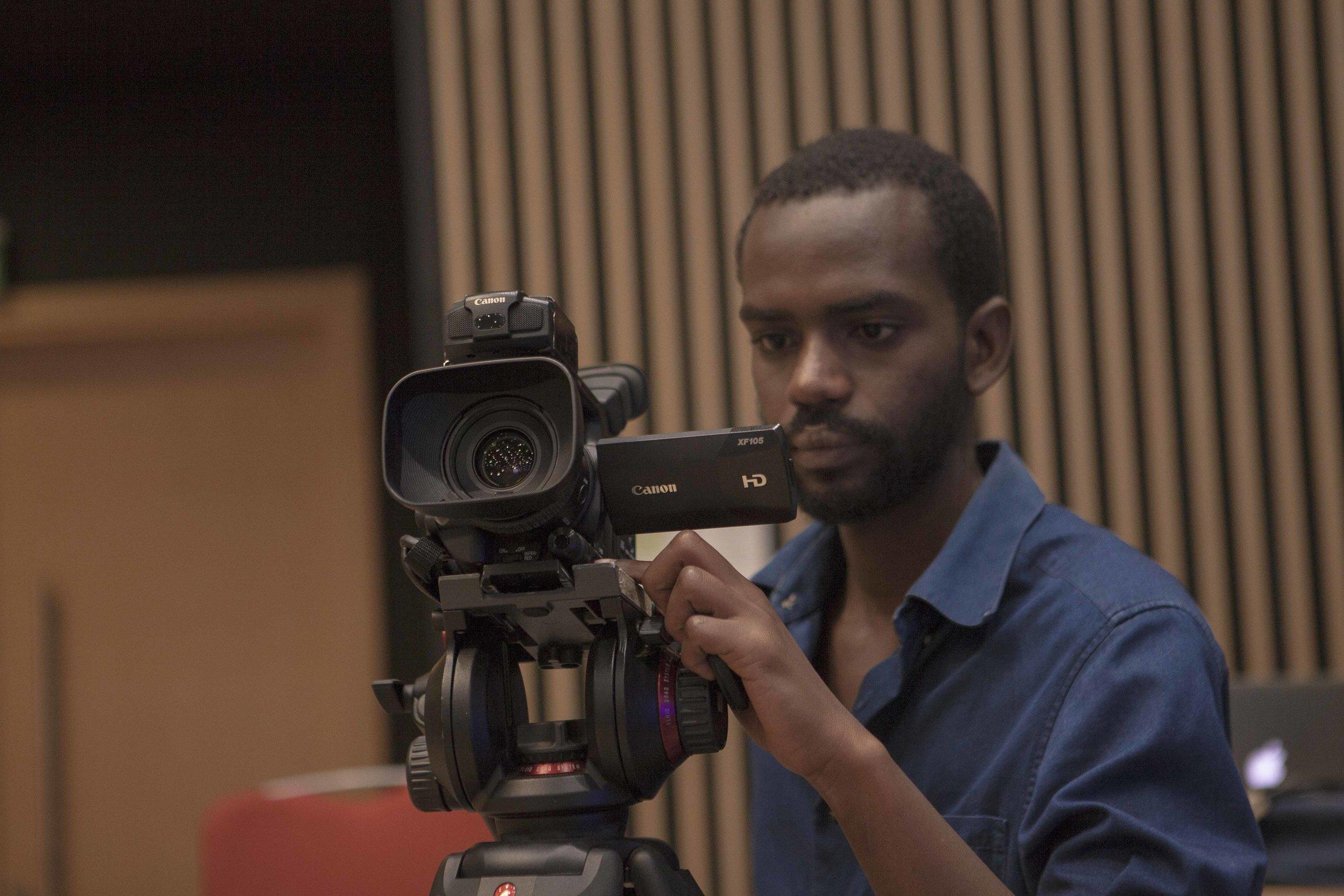 David, one of ADMA students setting up the camera