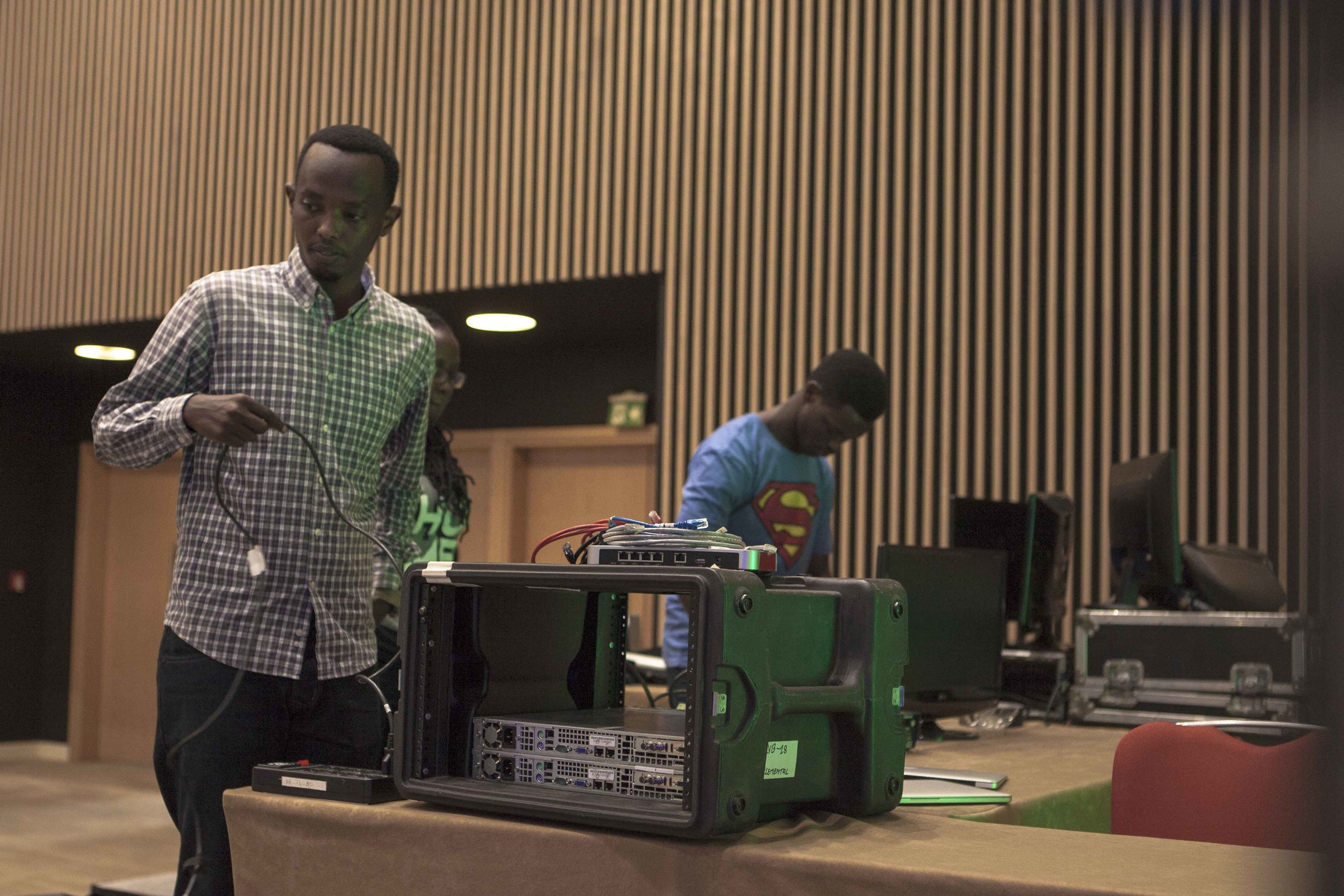 Alan and Bruce, two ADMA students, setting up the equipment that will be used for the live streaming