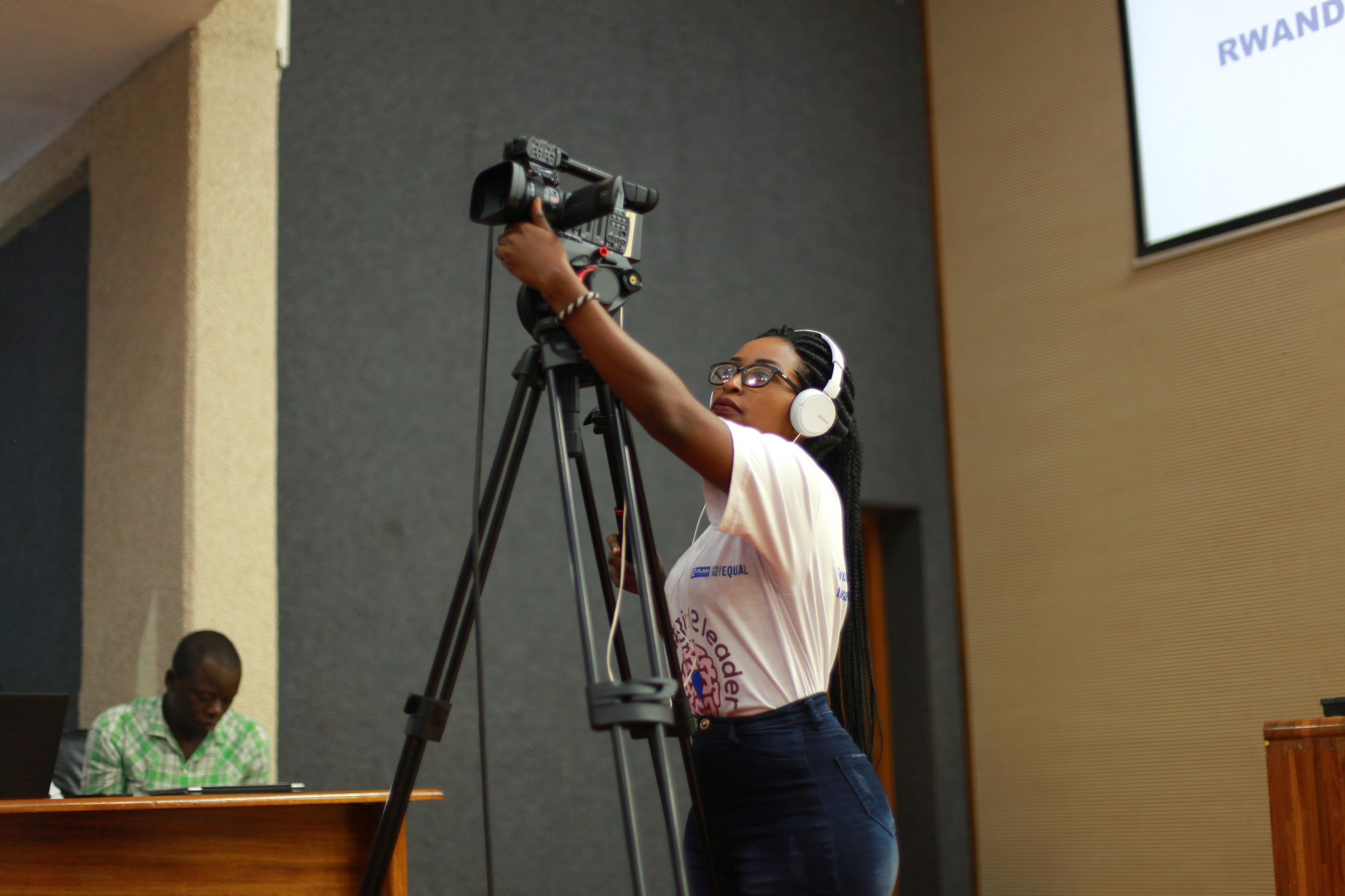 ADMA student Adeline, getting the high angle needed from her XF105 video camcorder.