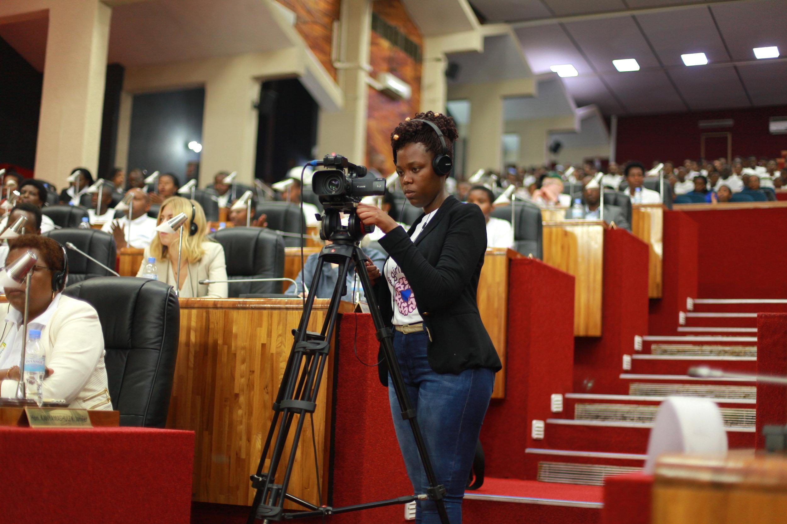 ADMA student Sandrine on an XF105, capturing video footage closeups of speakers on the main stage.