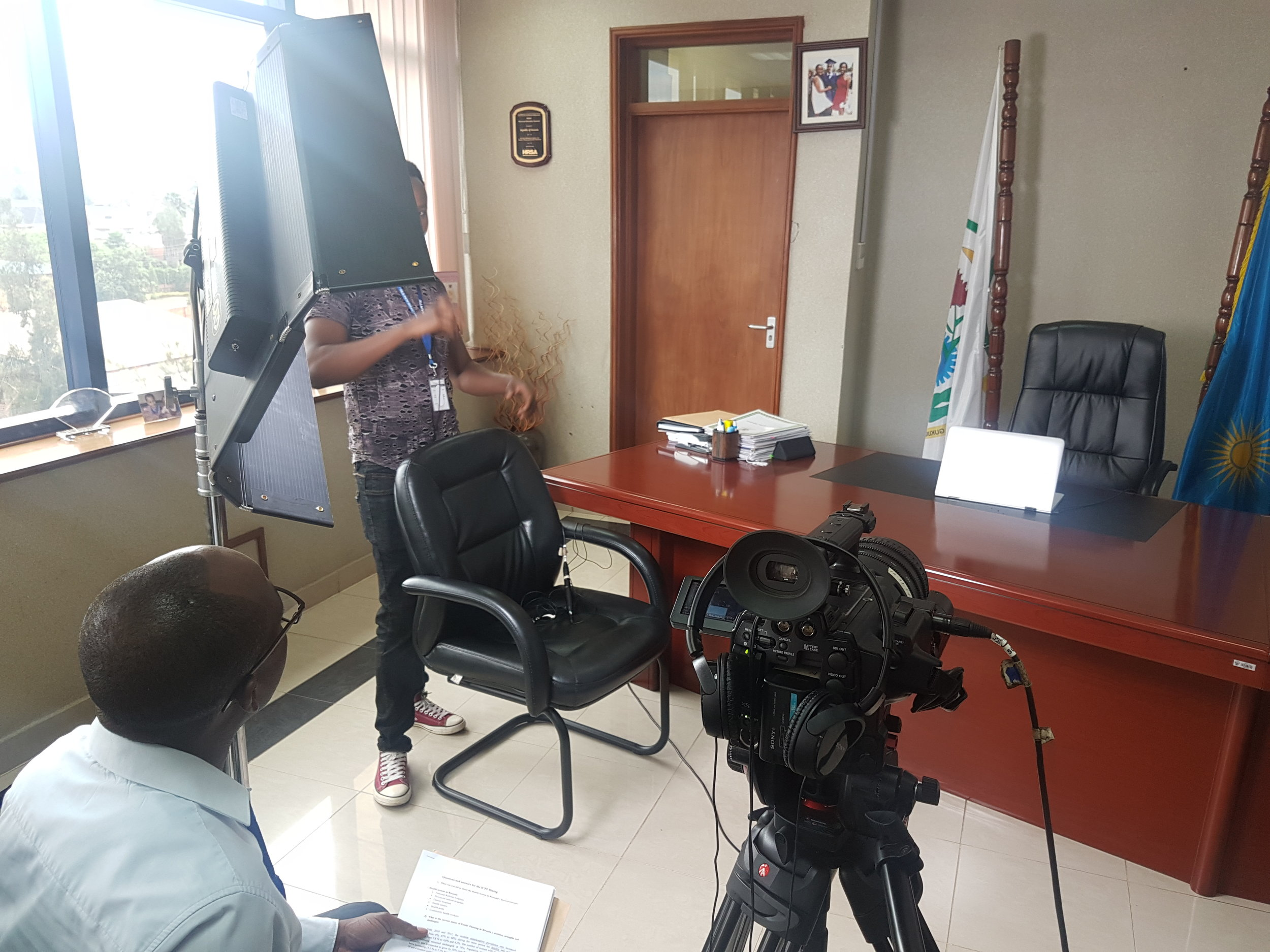 The Kino Flo Diva 401 light, Sony PMWF3, and student Hirwa Yves (behind the light) getting ready for the interview.