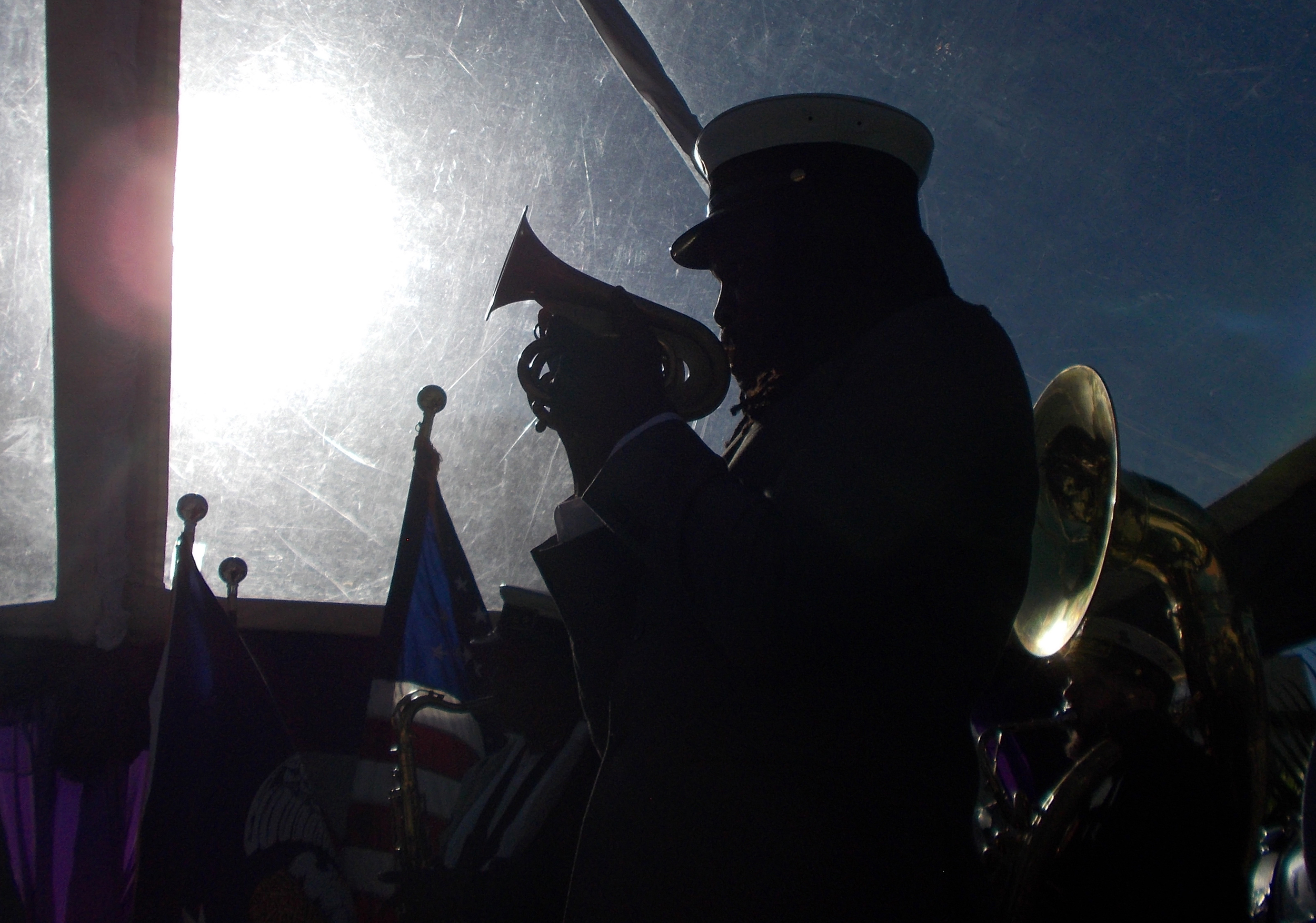 A member of the Tremé Brass Band is silhouetted against the sun as the band plays at the Rampart Streetcar Line ground breaking ceremony on January 28, 2015.