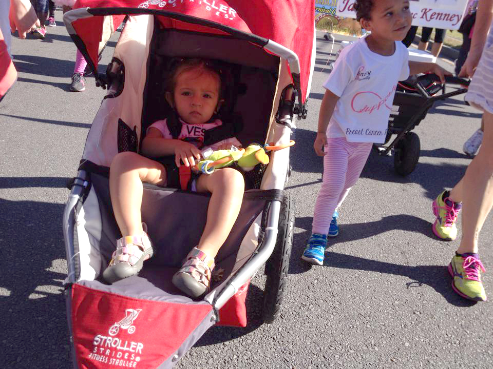 Olivia, left, and Desmond, children of Infinity Race for the Cure team members, take part in the 5K walk to raise awareness and funds for breast cancer.