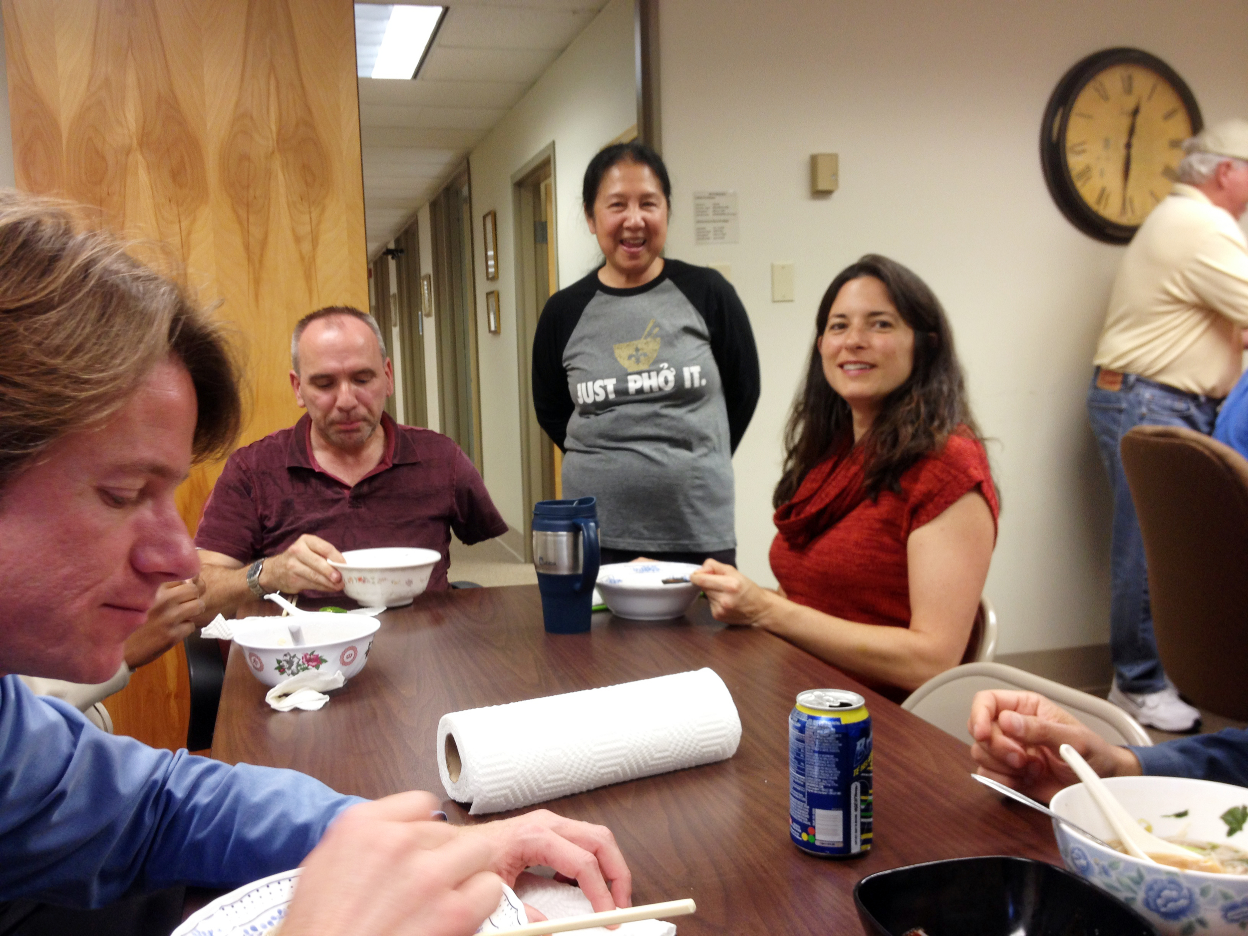 Infinity staff celebrate company and employee anniversaries with a pho lunch prepared by designer Phan Nguyen. From left, Bill Thomassie, Mike Laux, Phan Nguyen and Rachel Kenney.