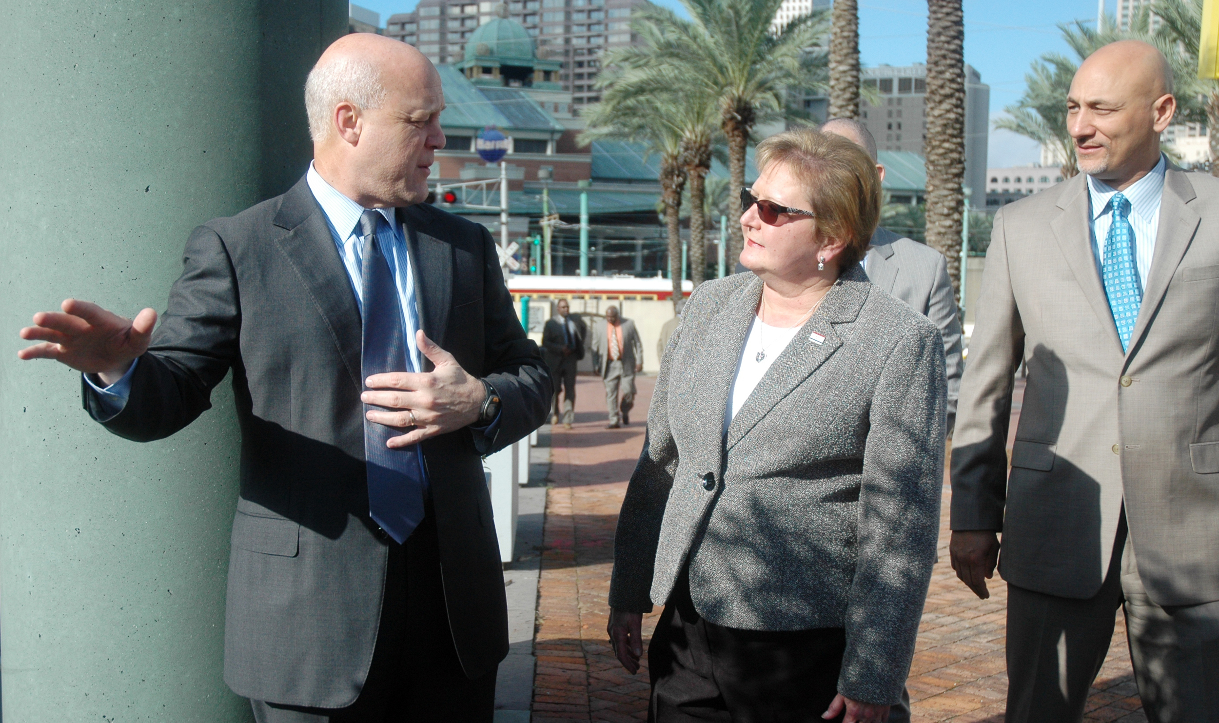 "Mayor Mitch Landrieu talks about the plans for the new Canal Street Ferry Terminal as he walks with District ""A"" Councilmember Susan Guidry and Infinity Engineering Principal Raoul V. Chauvin, III."