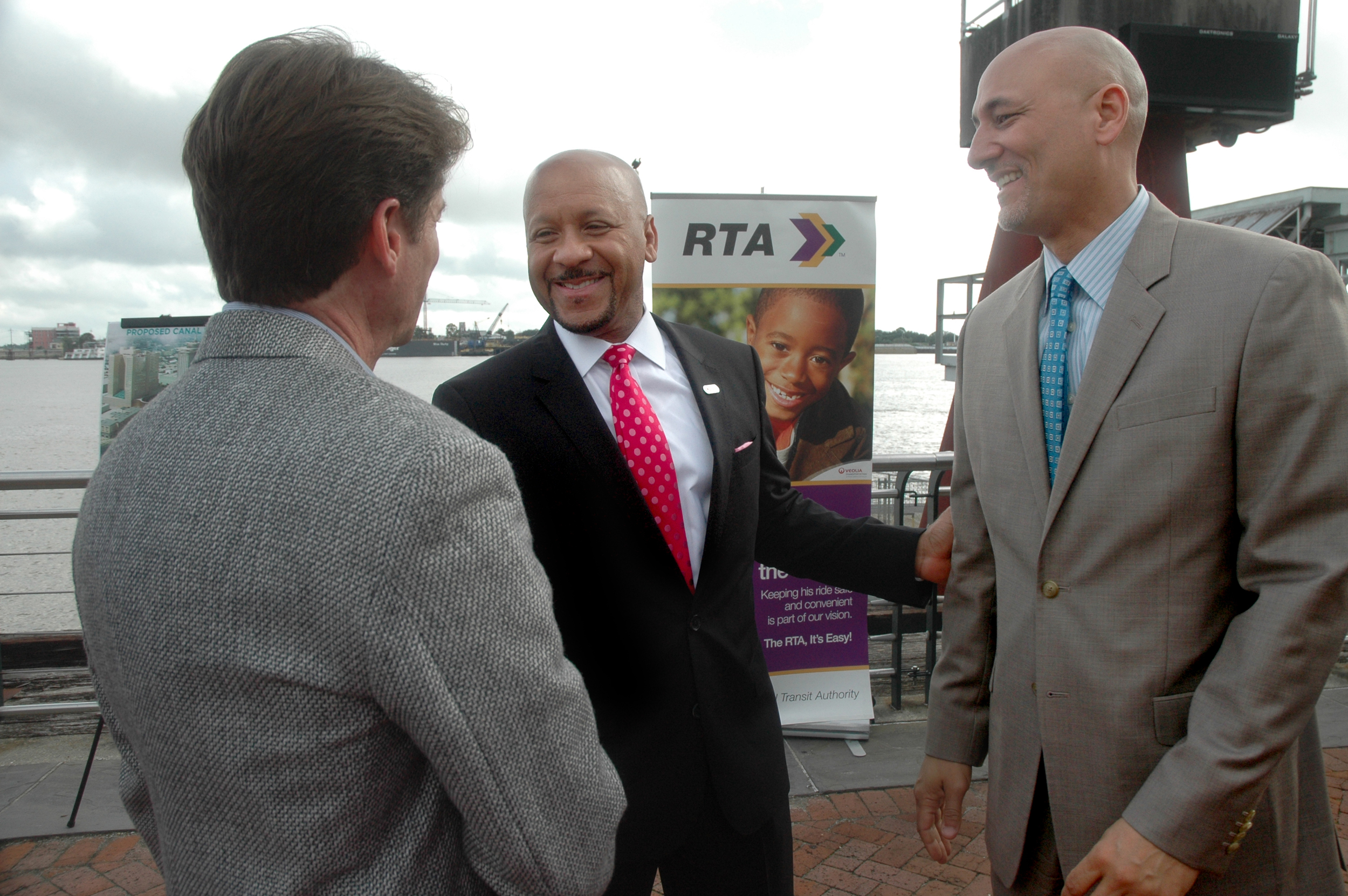 RTA CEO Justin Augustine, center, greets Infinity Engineering Principal Partners Bill Thomassie, left, and Raoul Chauvin after the press conference announcing the new Canal Street Ferry Terminal.