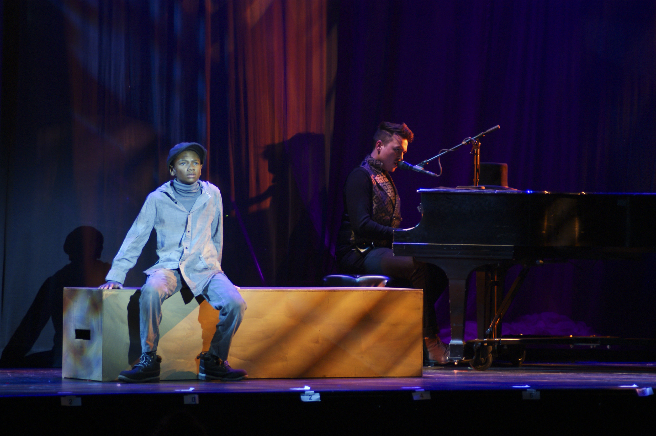 David Hopkins as Oliver Twist and composer_musician Jake Hull in Virginia Stage Company's Oliver Twist (photo by Crystal Tuxhorn).jpg