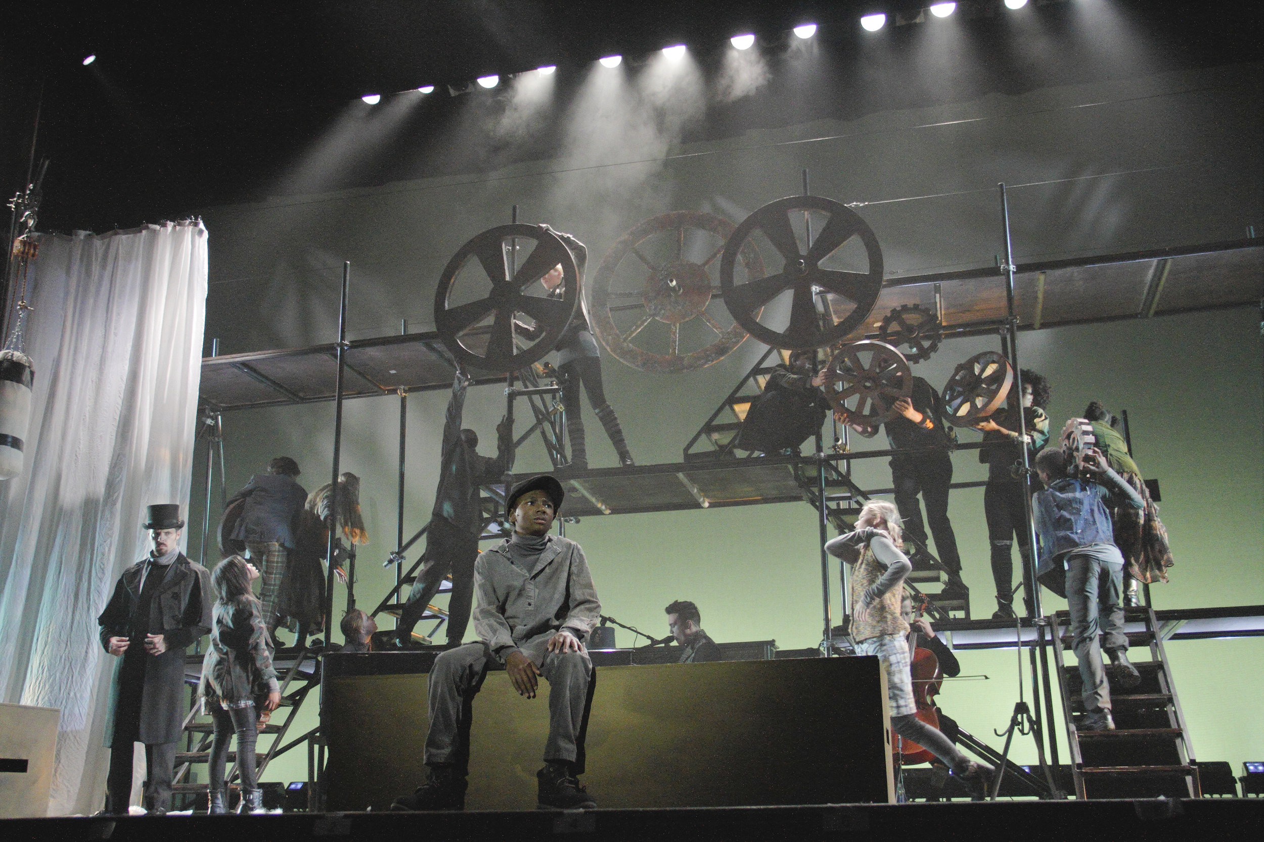 David Hopkins as Oliver Twist and the Ensemble in Virginia Stage Company's Oliver Twist.jpg