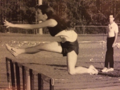 High School yearbook photo of me jumping way too high during the 100 meter hurdles.