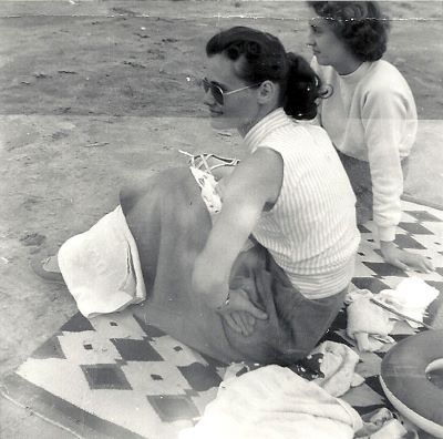 Grandma at the beach. I love her sunglasses.