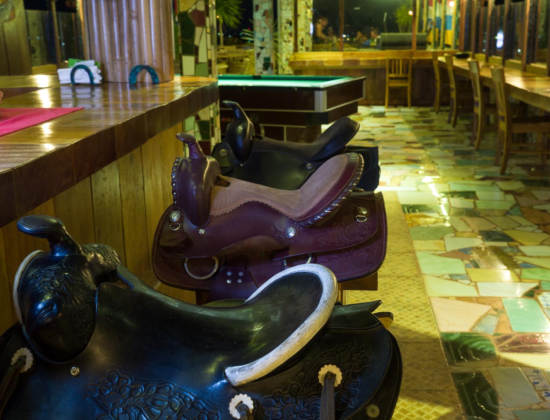 Hotel La Hasienda, Kupang, NTT, Indonesia. Detail from the restaurant, horse saddle bar stools.  Photo © Basil Rolandsen (http://media.bouvet.org)
