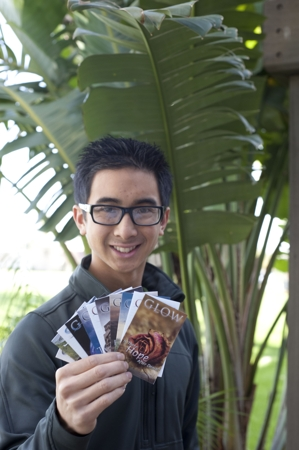 Full Circle Director Justin Khoe for the Southeastern California Conference, Calif., holding GLOW tracts.