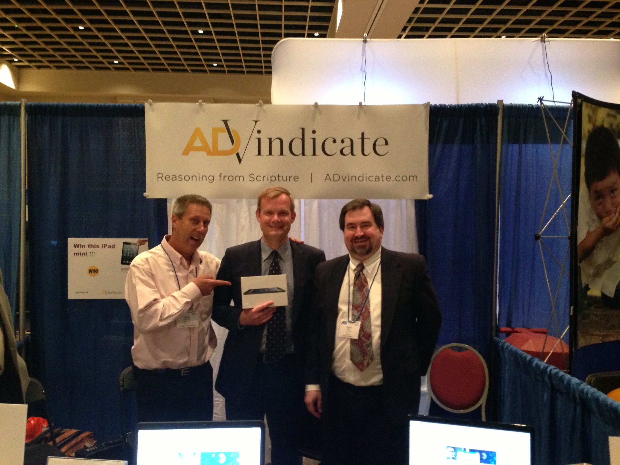 Gerry Wagoner and David Read stand with Marcel Wiggers, winner of the iPad Mini.